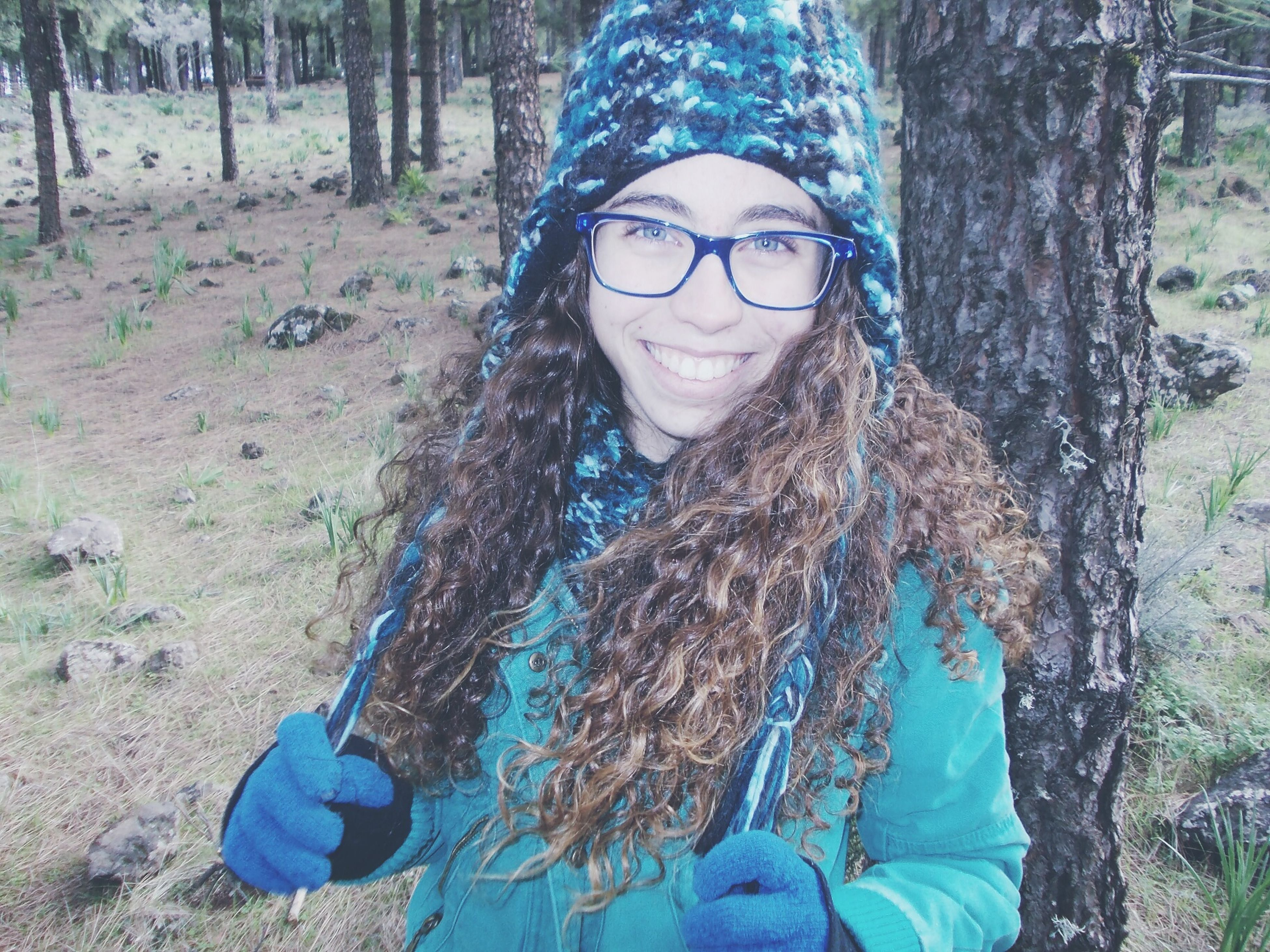 lifestyles, leisure activity, portrait, looking at camera, young adult, person, front view, casual clothing, sunglasses, headshot, tree, young women, smiling, happiness, standing, day, outdoors, forest