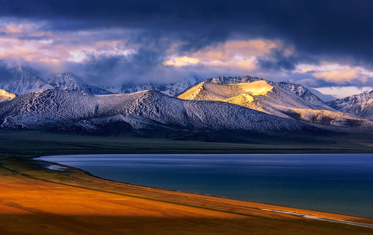 Sunrise of Lake Nam in Tibet Beauty In Nature Cloud - Sky Cold Temperature Glacier Lake Landscape Mountain Mountain Peak Mountain Range Namtsolake Nature No People Outdoors Scenics Sky Snow Snowcapped Mountain Sunrise Tibet Travel Destinations Water Winter