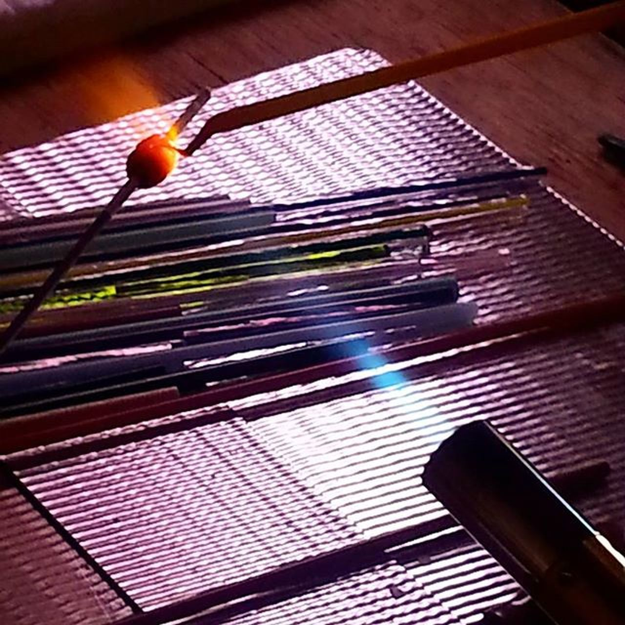"""Do something creative everyday."" This is a glass bead in its infancy. With care, attention, and a bit of fire, it will grow into something beautiful! Nowbeadthis Beads * Handmadejewelry * Beading Crafty Craft Crafts * Madeinusa Madeinarizona Lampworked Beads Lampwork Torch Workbench Glass Art Glass Rods Torching Glass Glass Artistry Glass Artist Glass Artwork Artist's Workshop Artist's Hands Glass Bead On Mandrel Glass Shaping Melting Glass Molten Glass"