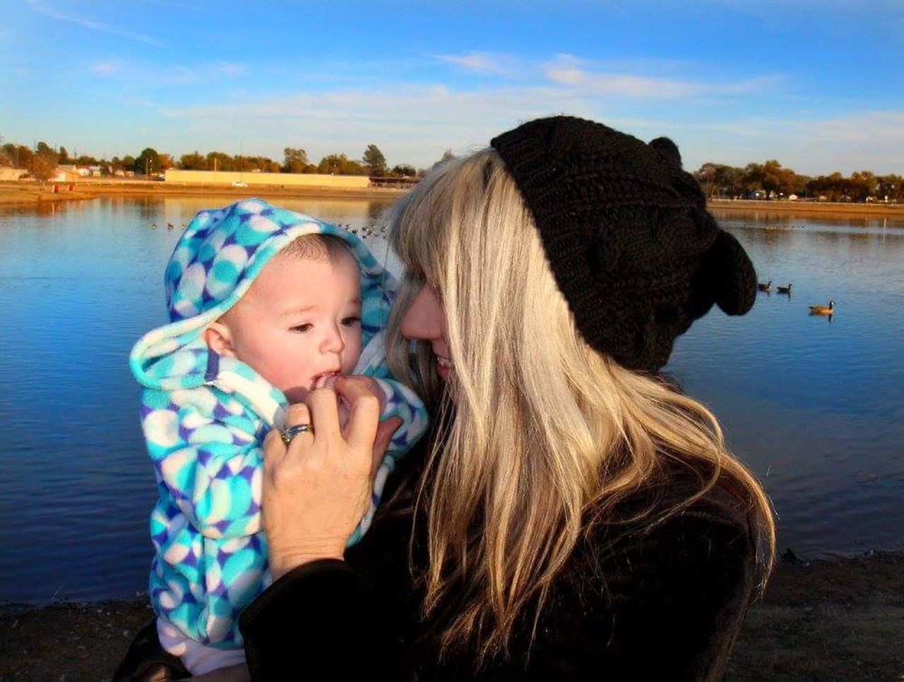 Togetherness Two People Family People Happiness Water Lake Outdoors Winter Mature Adult Adult Baby Bonding Nature Females Warm Clothing Day Sky Self Potrait Grandmother&granddaughter Sunset Lakeshore Lake View