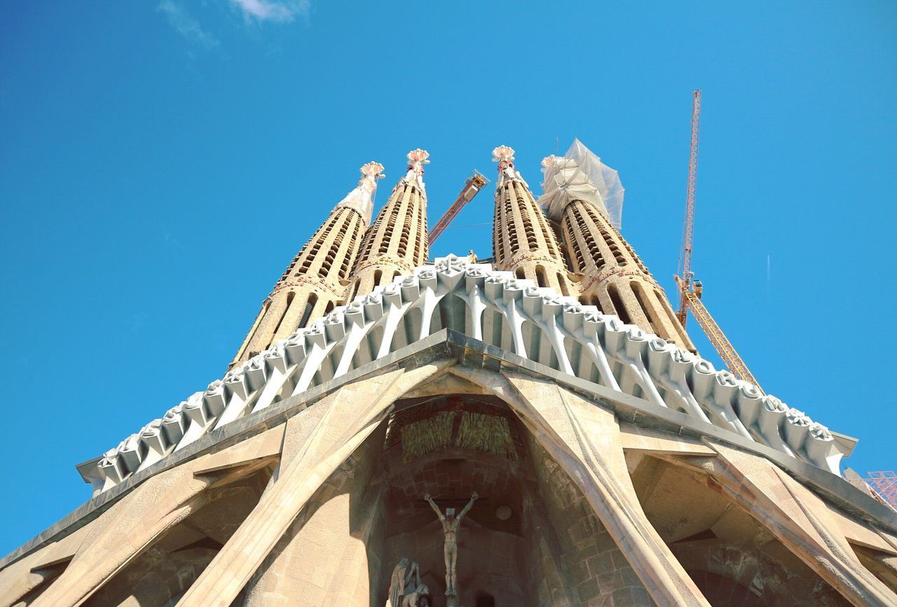 Sagrada Familia Low Angle View Religion Building Exterior Built Structure Architecture Place Of Worship Blue Spirituality Day Sunlight Sky Clear Sky No People Outdoors Barcelona Gaudi Sagrada Familia Passion Nativity Art SPAIN Neighborhood Map