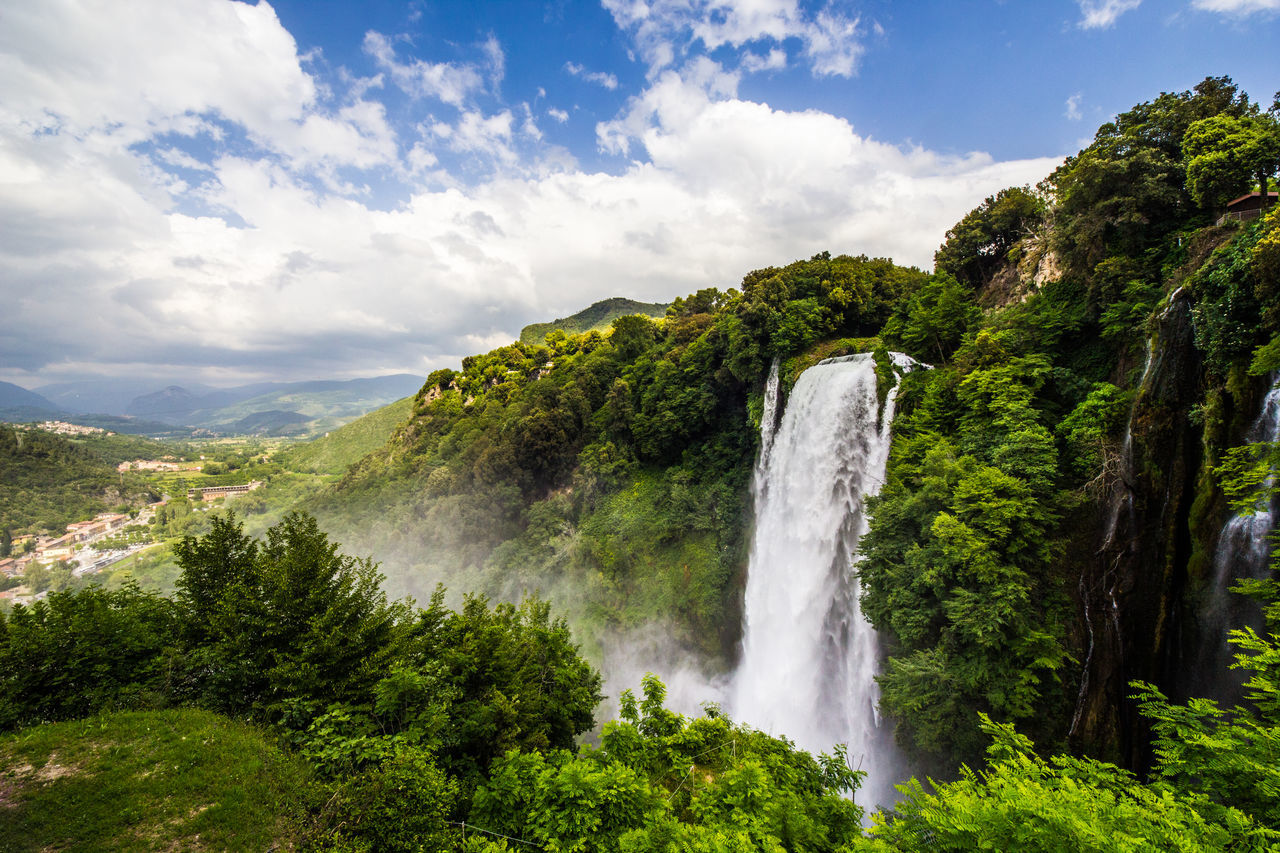Waterfall of Marmore Beauty Beauty In Nature Cloud - Sky Day Forest Freshness Green Color Landscape Lush - Description Marmore Falls Motion Mountain Nature No People Outdoors Scenics Sky Social Issues Terrace Tourism Travel Destinations Tree Vacations Water Waterfall