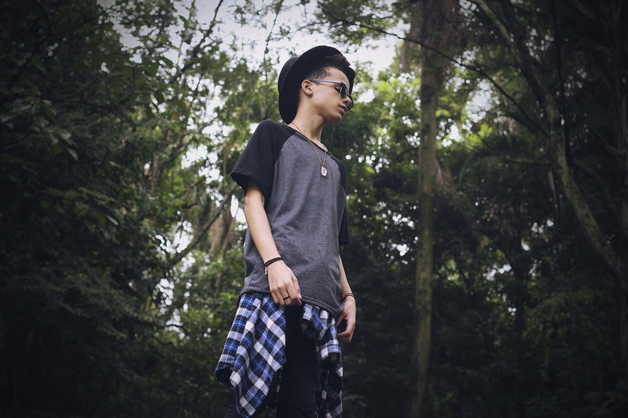 Adult Adults Only Beauty Cheerful Day Day Dreaming Happiness Hipster Low Angle View Nature One Person One Young Man Only Only Women Outdoors People Smiling Style Tree Young Adult Young Man