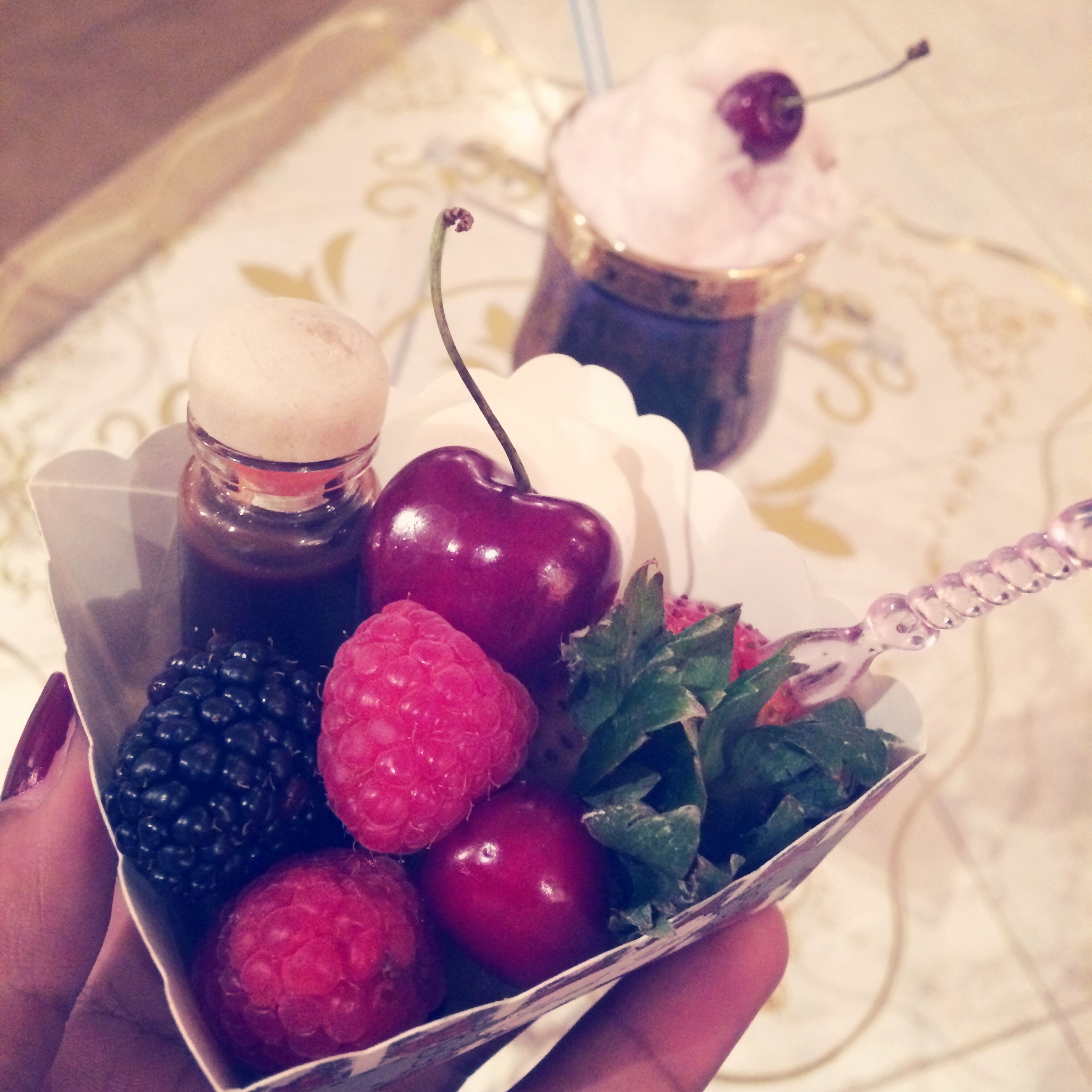 food and drink, indoors, food, freshness, fruit, healthy eating, table, still life, strawberry, one person, sweet food, indulgence, high angle view, ready-to-eat, close-up, holding, dessert, person, plate, temptation