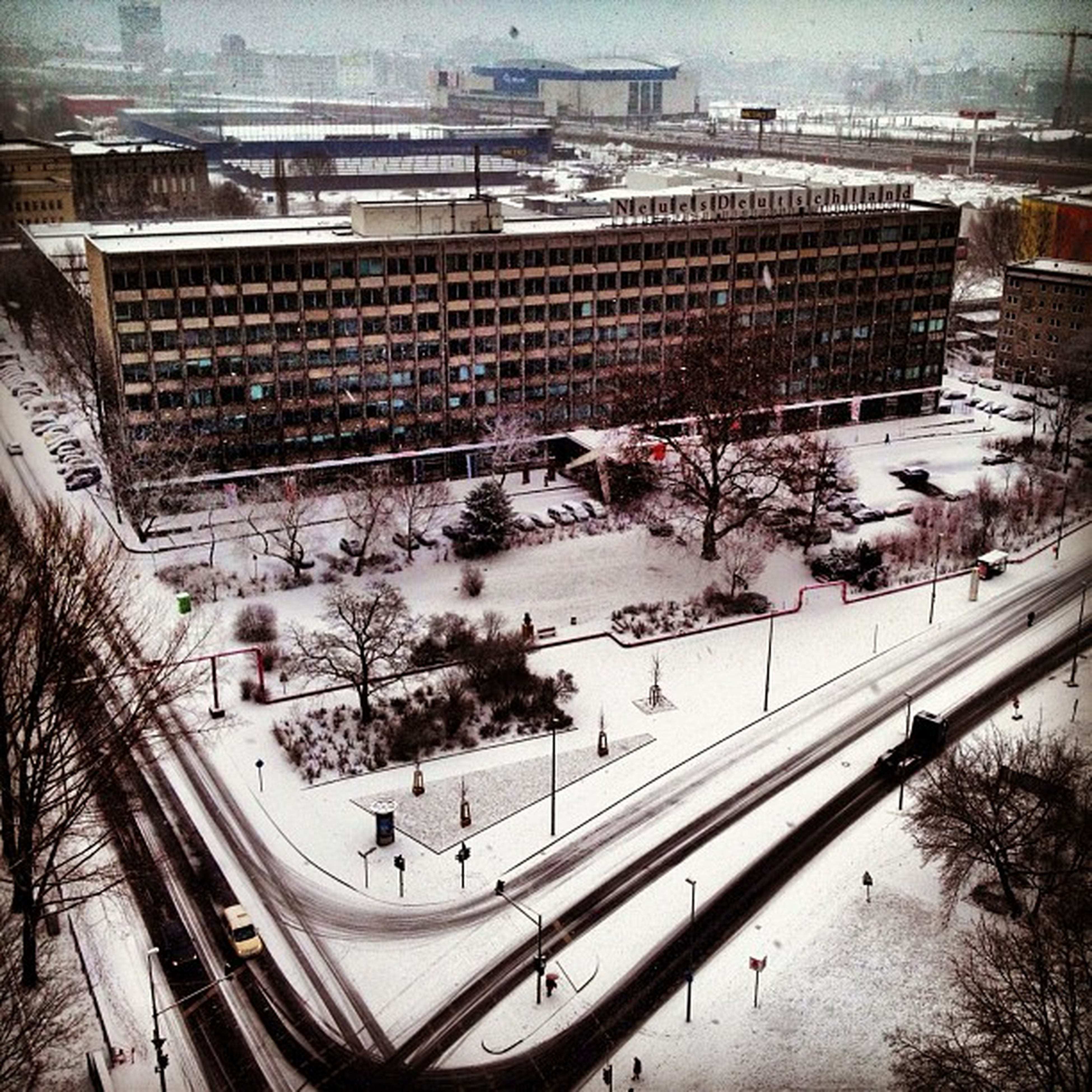 snow, winter, cold temperature, architecture, season, high angle view, built structure, building exterior, transportation, large group of people, weather, city, covering, city life, mode of transport, car, street, road, land vehicle