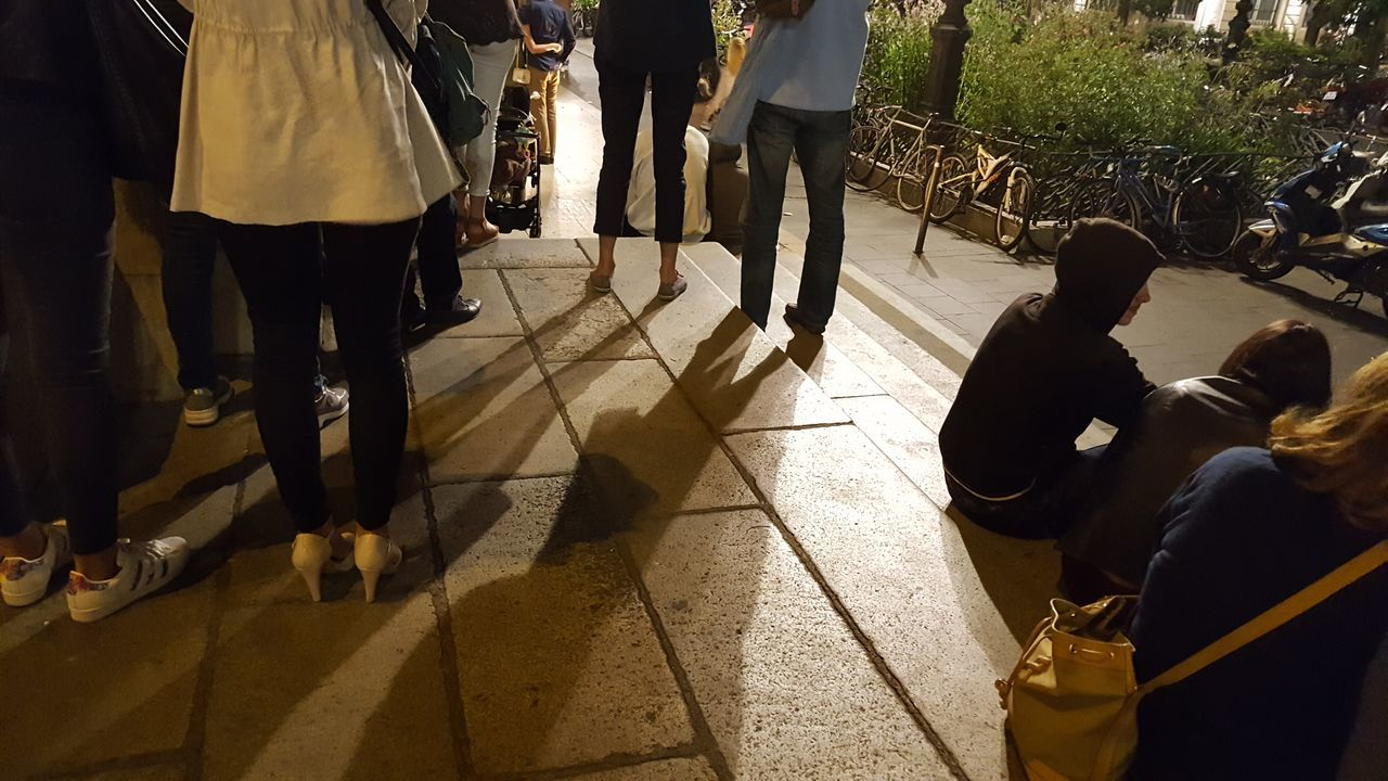 Large Group Of People Low Section Adults Only Shadow Outdoors People Night Photography 14 Juillet 2017 Fête Nationale Night Lights People Sitting People Standing Connected By Travel