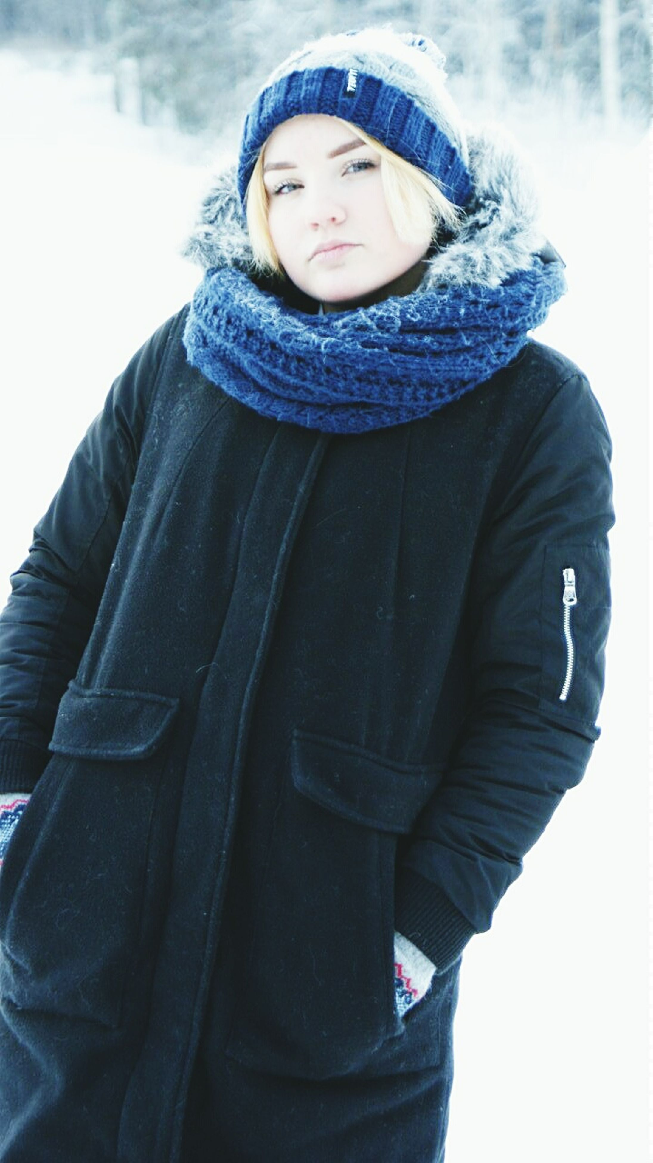 casual clothing, portrait, looking at camera, front view, lifestyles, person, young adult, leisure activity, three quarter length, standing, warm clothing, jacket, young women, smiling, waist up, low angle view, scarf