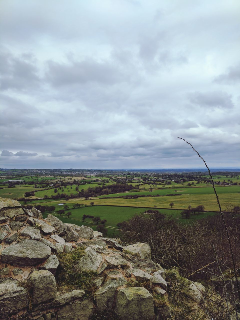 sky, cloud - sky, nature, landscape, tranquility, day, field, tranquil scene, outdoors, no people, beauty in nature, scenics, rock - object, tree