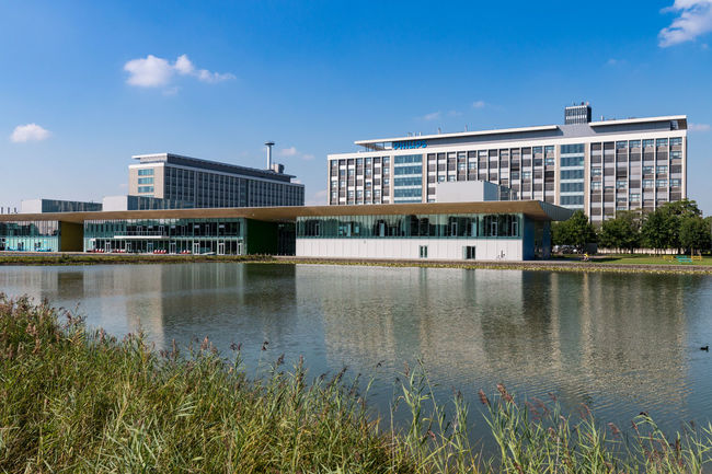 The High Tech Campus Eindhoven is a high tech center and R&D ecosystem on the Southern edge of the Dutch city of Eindhoven. In 2016, the High Tech Campus is home to more than 140 companies and institutions, comprising over 10,000 R&D-staff and entrepreneurs and an estimated 85 nationalities. Architecture Built Structure Campus Hightech Innovation International Life Science Research And Development Science And Technology