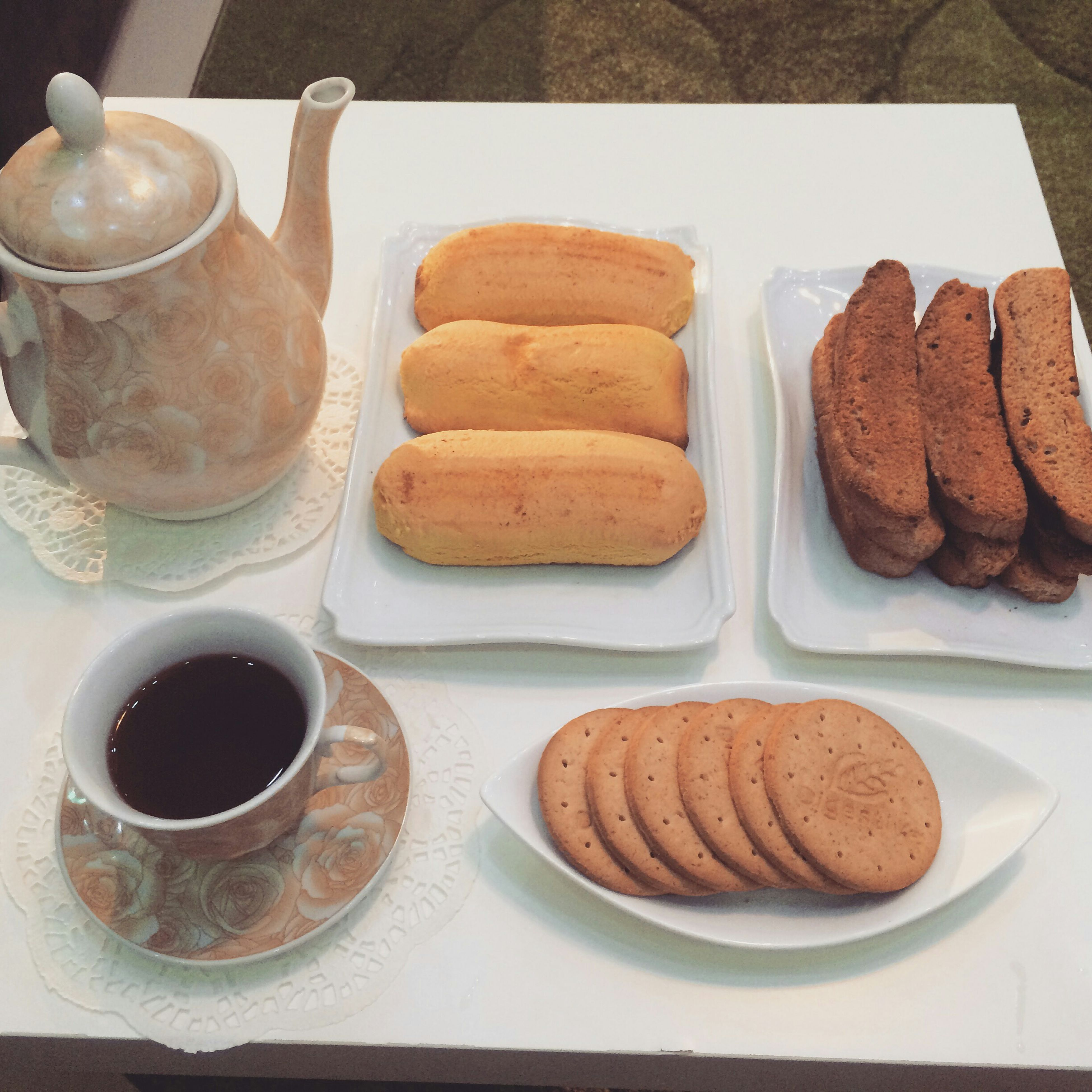 food and drink, indoors, food, freshness, still life, ready-to-eat, plate, table, sweet food, bread, breakfast, indulgence, unhealthy eating, dessert, refreshment, drink, baked, coffee - drink, high angle view, coffee cup