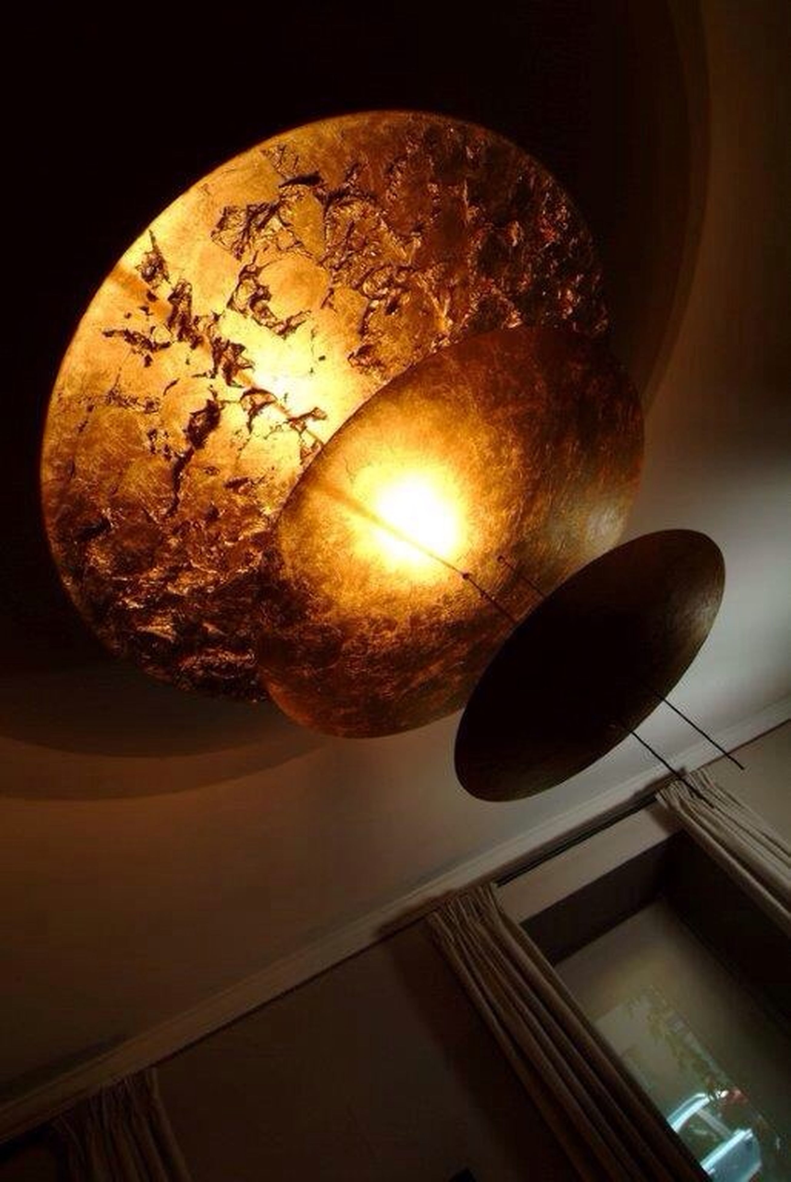 low angle view, illuminated, lighting equipment, indoors, ceiling, hanging, electric lamp, night, light bulb, electricity, built structure, architecture, electric light, decoration, lantern, chandelier, directly below, glass - material, no people, light - natural phenomenon