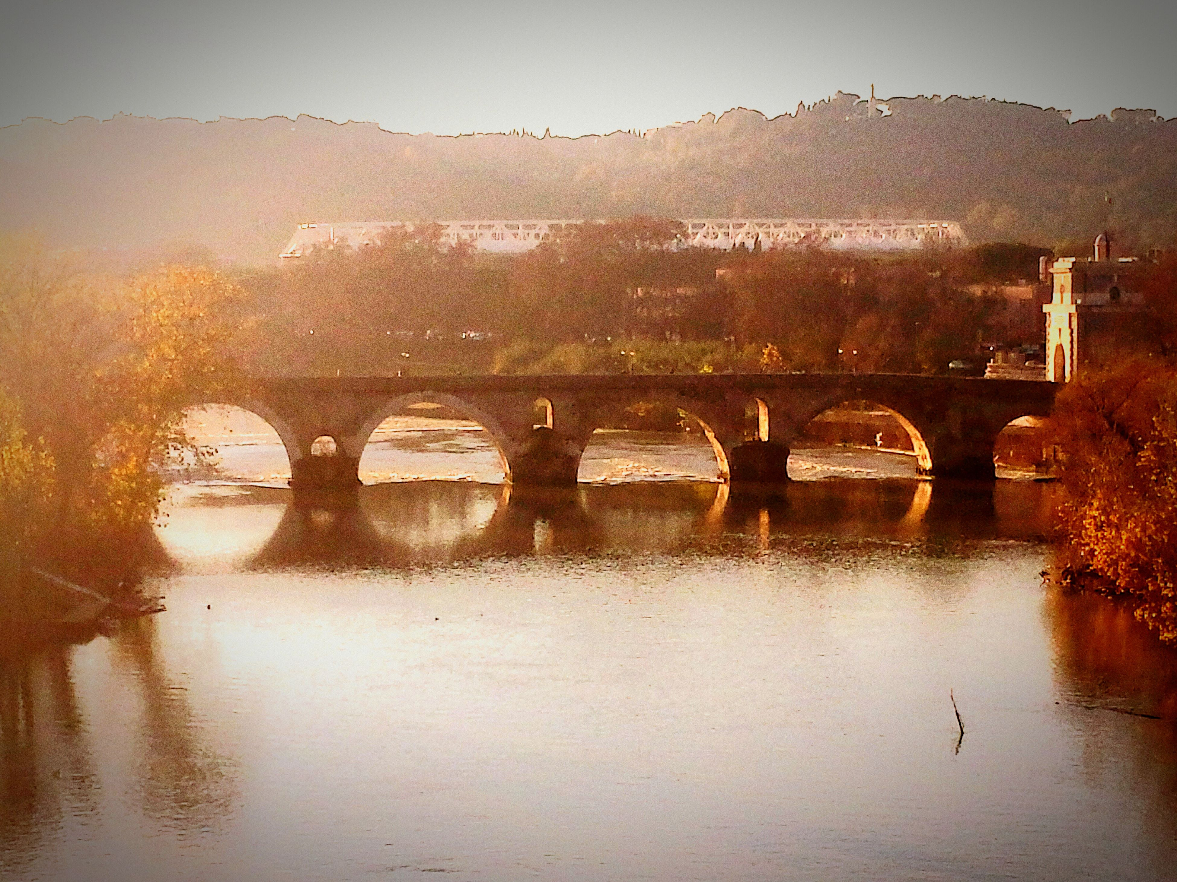 water, built structure, architecture, reflection, bridge - man made structure, river, connection, waterfront, tranquil scene, tranquility, sky, tree, nature, scenics, lake, arch bridge, mountain, bridge, landscape, beauty in nature