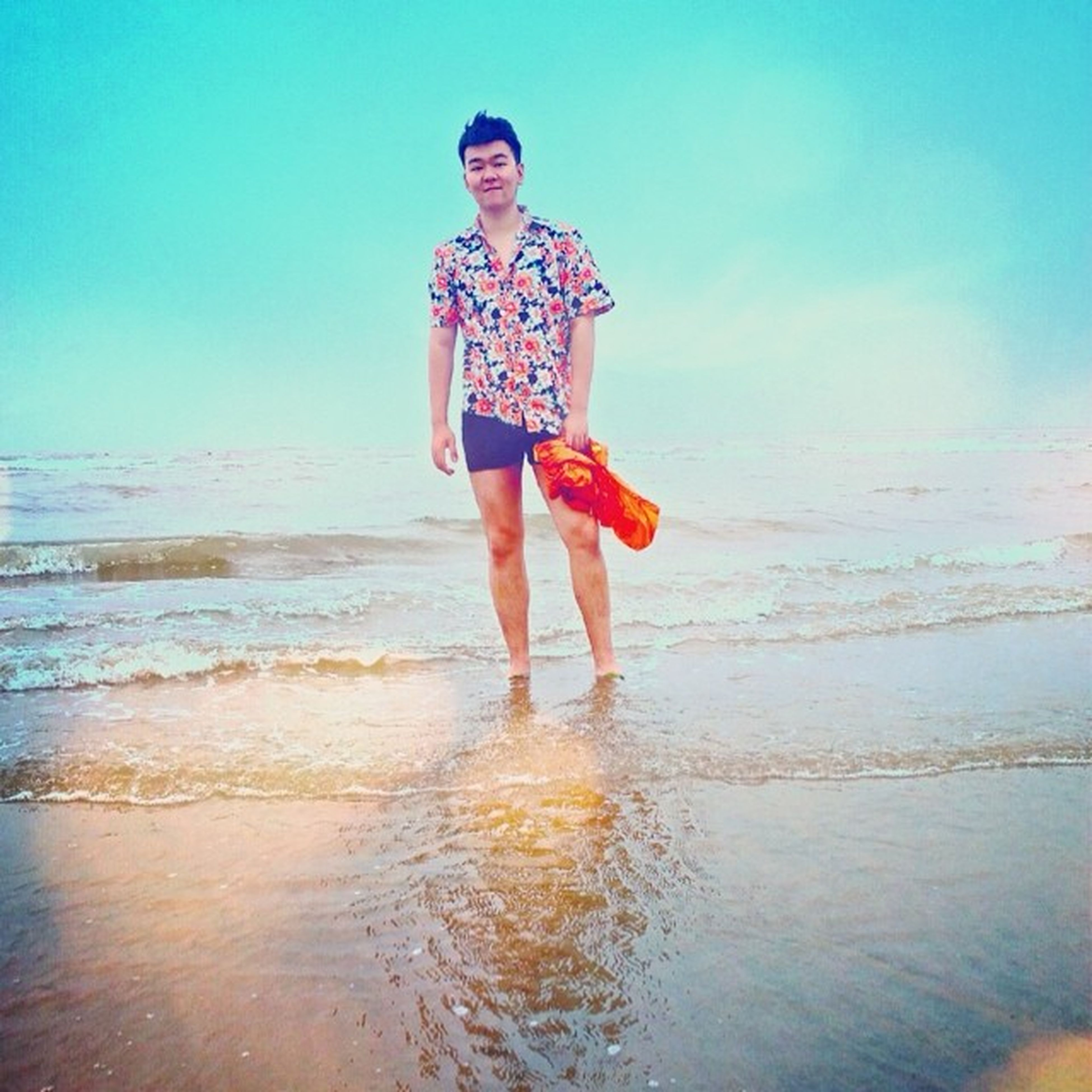 beach, water, sea, full length, lifestyles, person, sand, leisure activity, shore, vacations, young adult, casual clothing, childhood, front view, horizon over water, standing, looking at camera, portrait