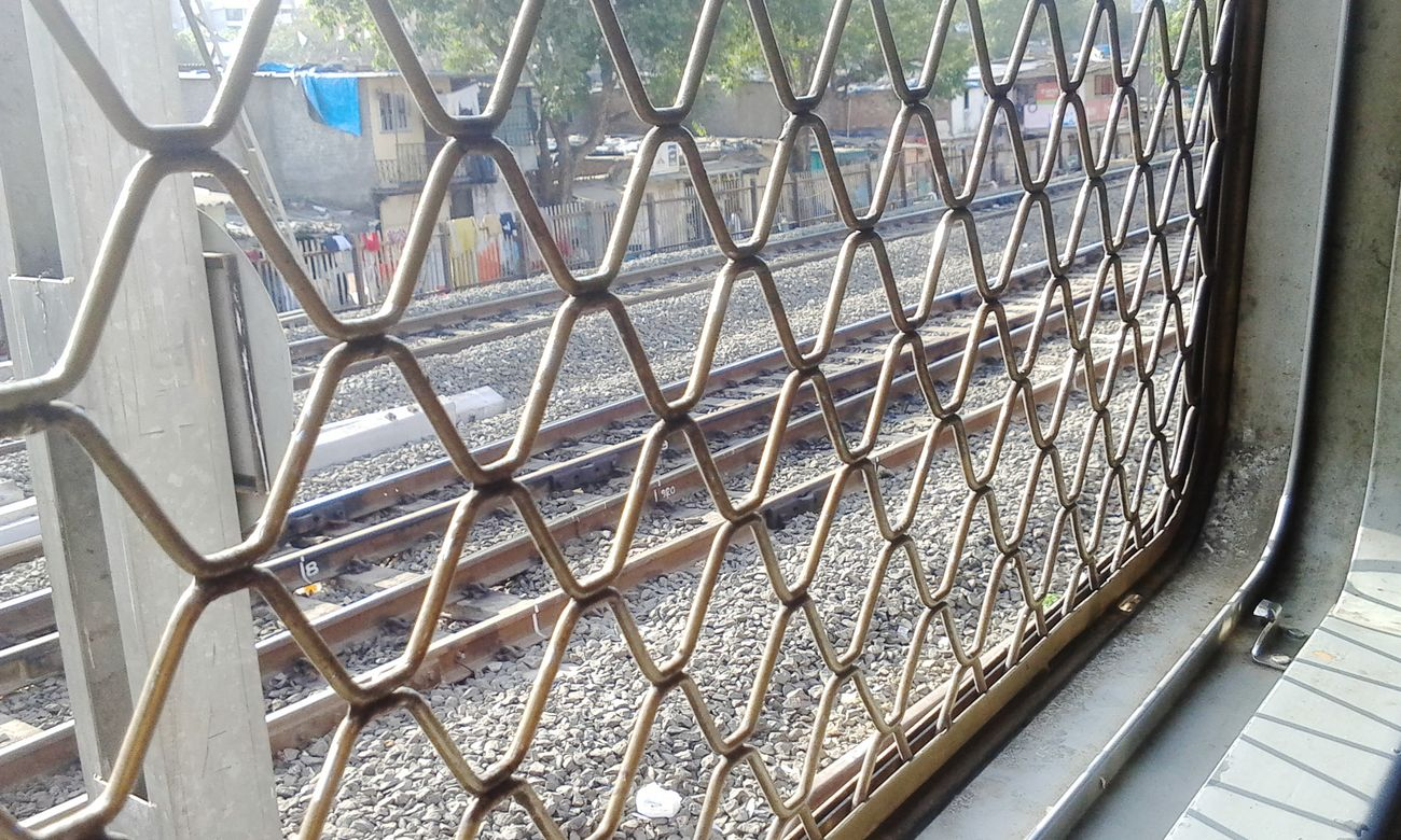 Clicked by me Awesome_captures Local Traveling Random House Reflection_collection Sunlight, Shades And Shadows Moving Fast Sunlight ☀ Local Transportation Train Tracks Light And Shadow Behind The Grill Train Window Trainphotography Click click 📷📷📷 by AwesomeAisha_24 in Maharashtra India