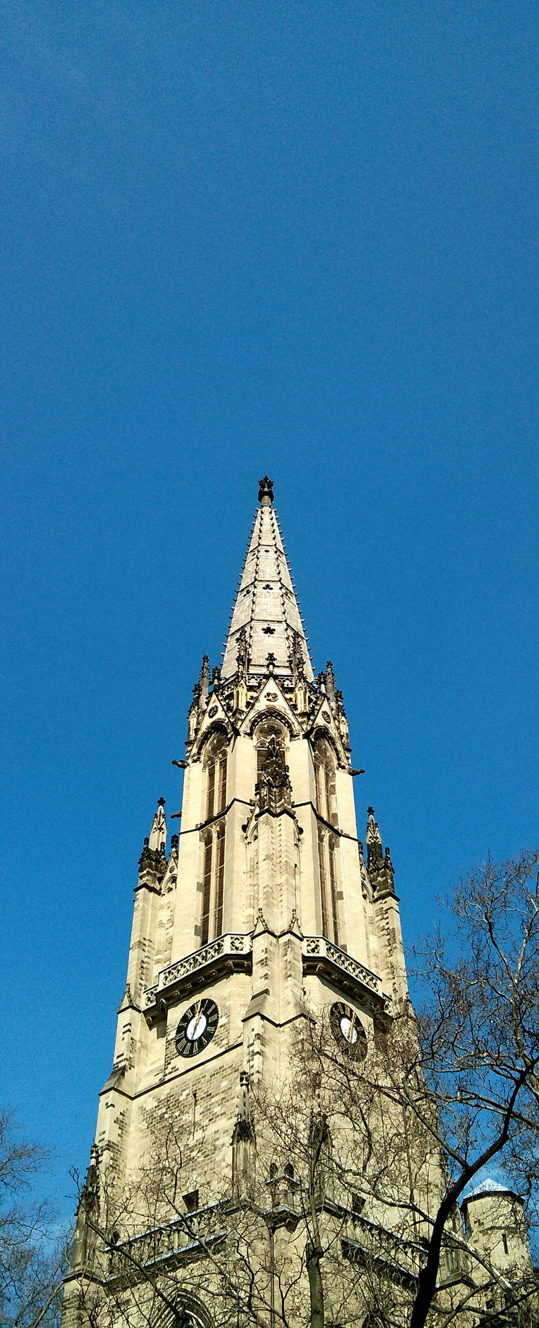 clear sky, architecture, building exterior, built structure, low angle view, copy space, blue, tower, religion, place of worship, high section, history, church, spirituality, no people, outdoors, day, clock tower, sunlight