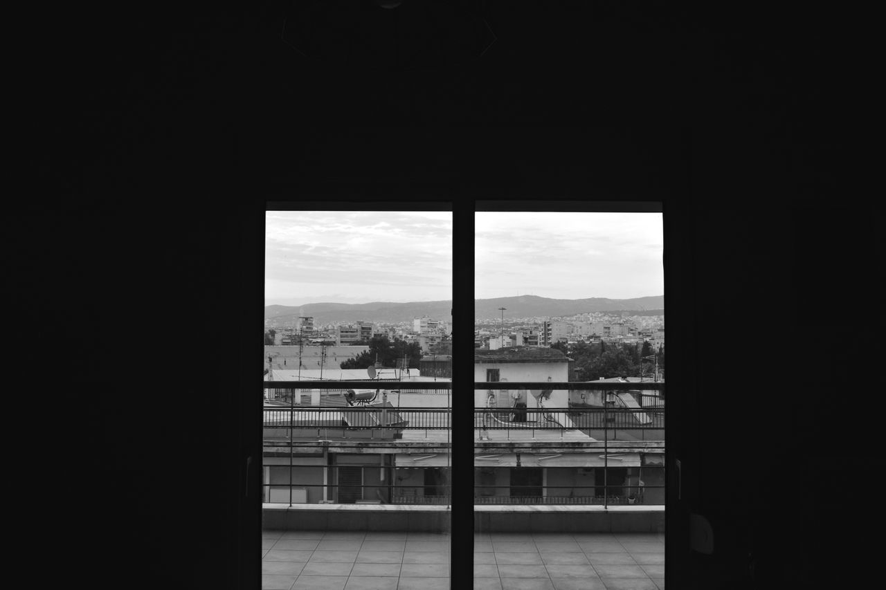 window, indoors, built structure, architecture, sky, day, no people, building exterior, nature, cityscape, city