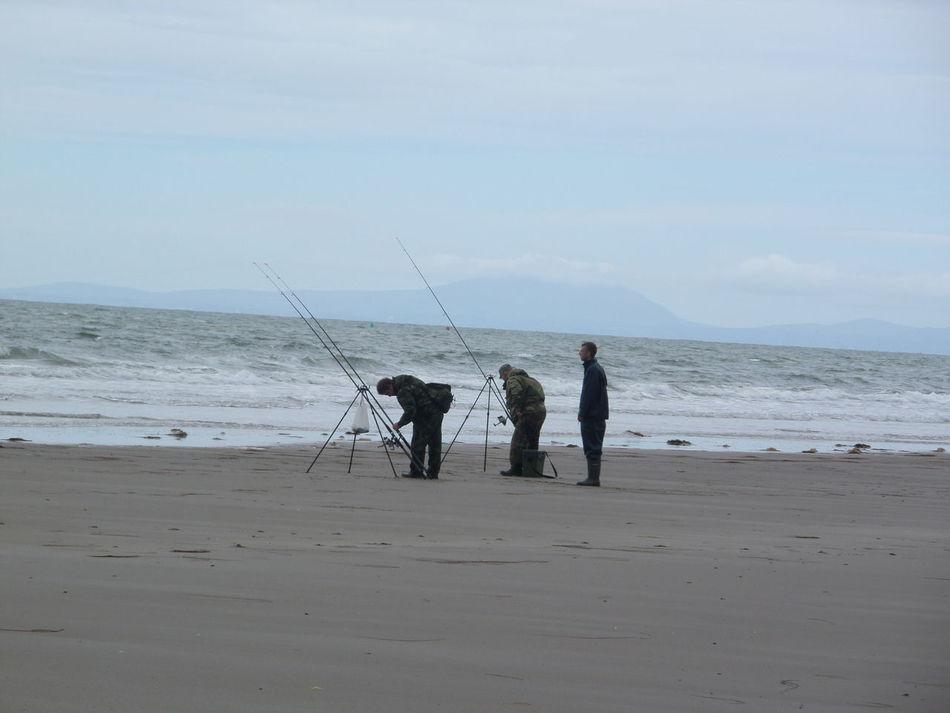 Taking Photos On Fairbourne Beach Fishing Man