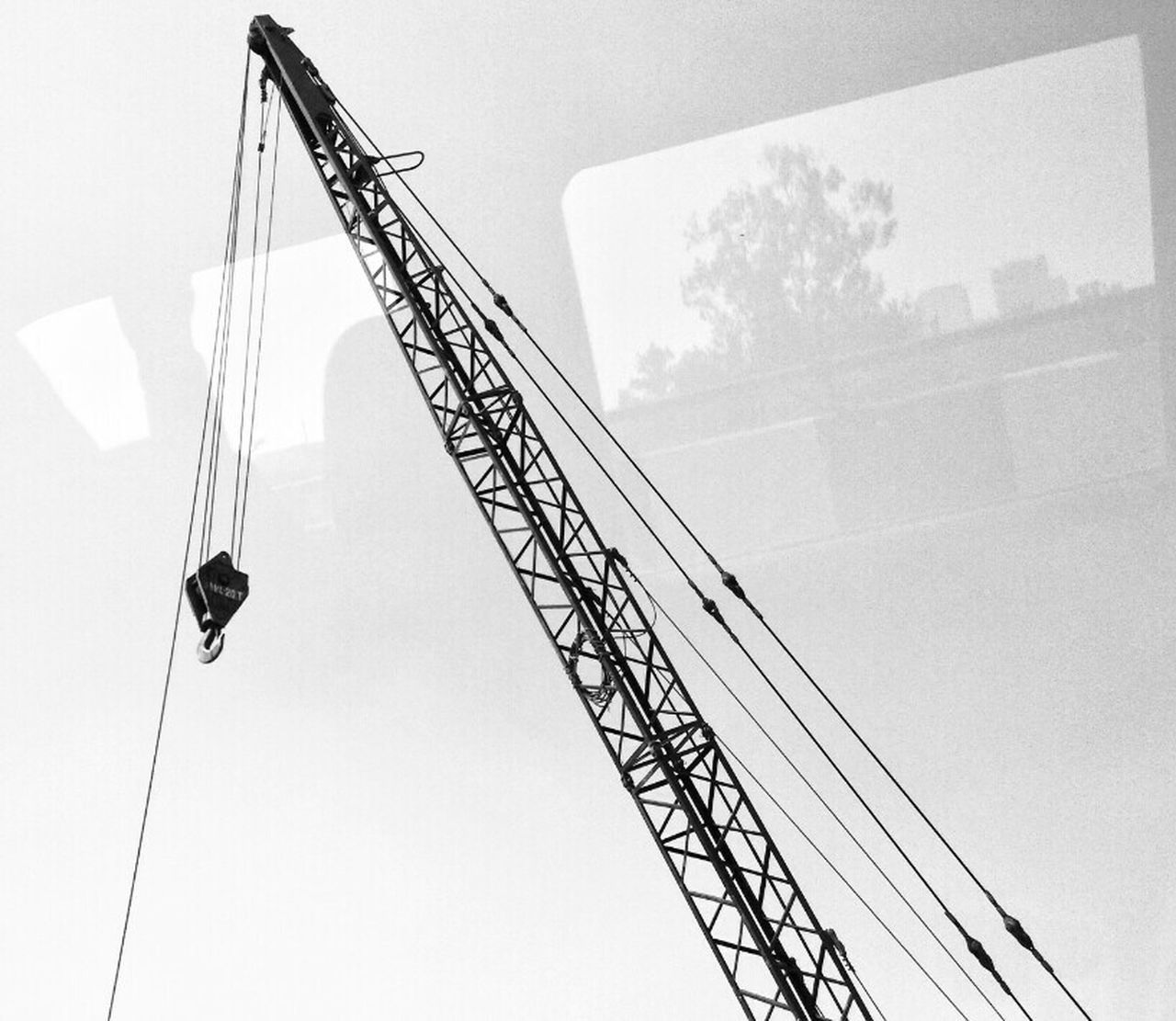 crane - construction machinery, construction site, low angle view, development, construction, construction machinery, working, day, building - activity, industry, crane, architecture, occupation, built structure, outdoors, no people, sky