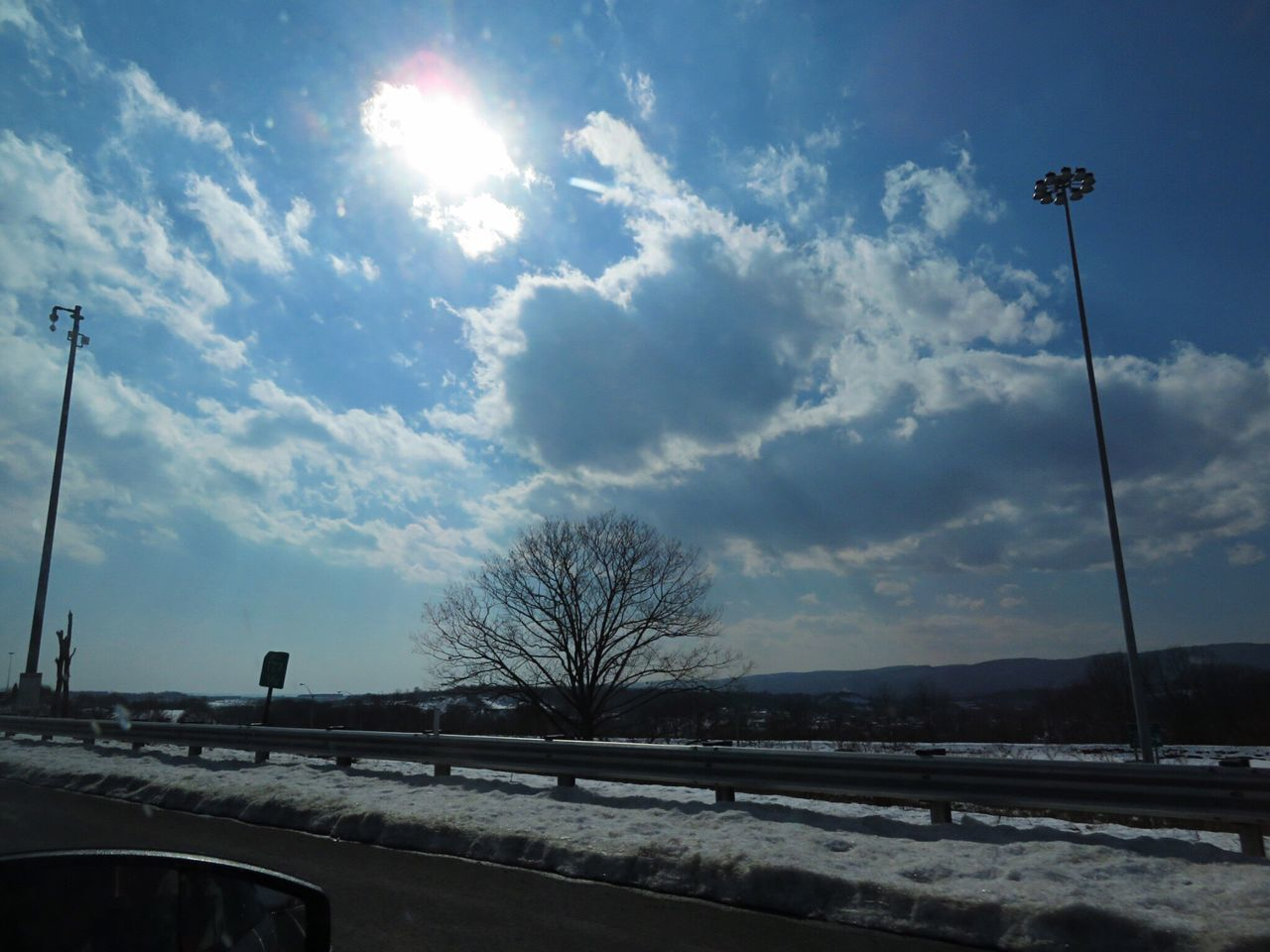 Sky Road Transportation Tree Daytime Sun Bare Tree Car No People Outdoors Sunlight Cloud - Sky Day Nature Driving Ontheroad Through The Window Architecture