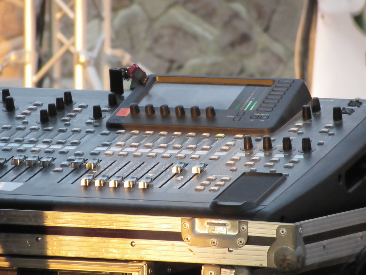 Professional audio mixing console with faders and adjusting knobs for party outdoor at sunset Adjuster Audio Equipment Board Button Concert Console Desk Disco Dj Entertainment Equalizer Event Fader Knob Mixer Music Musical Equipment Outdoor Party Sound Sound Mixer Soundboard System Technology Volume