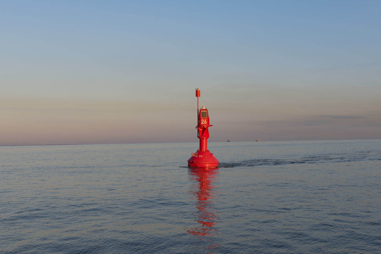 Orange buoy on the Elbe to delineate Boat Boundary Buoy Coast Danger Demarcation Elbe Firmly Lashed Marking Moored Mooring Line Navigation River Rope Leash Sea Security Shaft Ship Tailed Tau Warning
