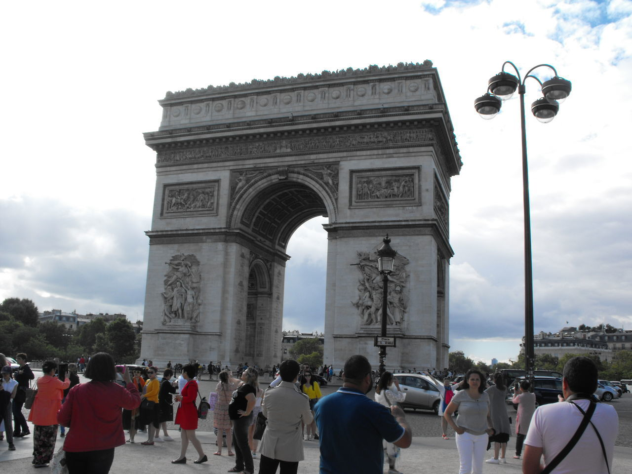 sky, large group of people, architecture, built structure, history, tourism, triumphal arch, real people, travel destinations, cloud - sky, outdoors, travel, women, day, city, people