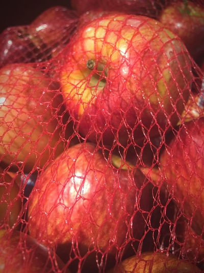 Trapped Apples In A Bag Net Bag Red Color Grocery Shopping Close Up Macro Photography Home Is Where The Art Is Colour Of Life Taking Photos Bold Colors Color Palette
