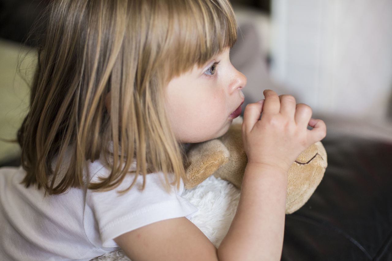 childhood, innocence, real people, one person, blond hair, focus on foreground, indoors, close-up, day