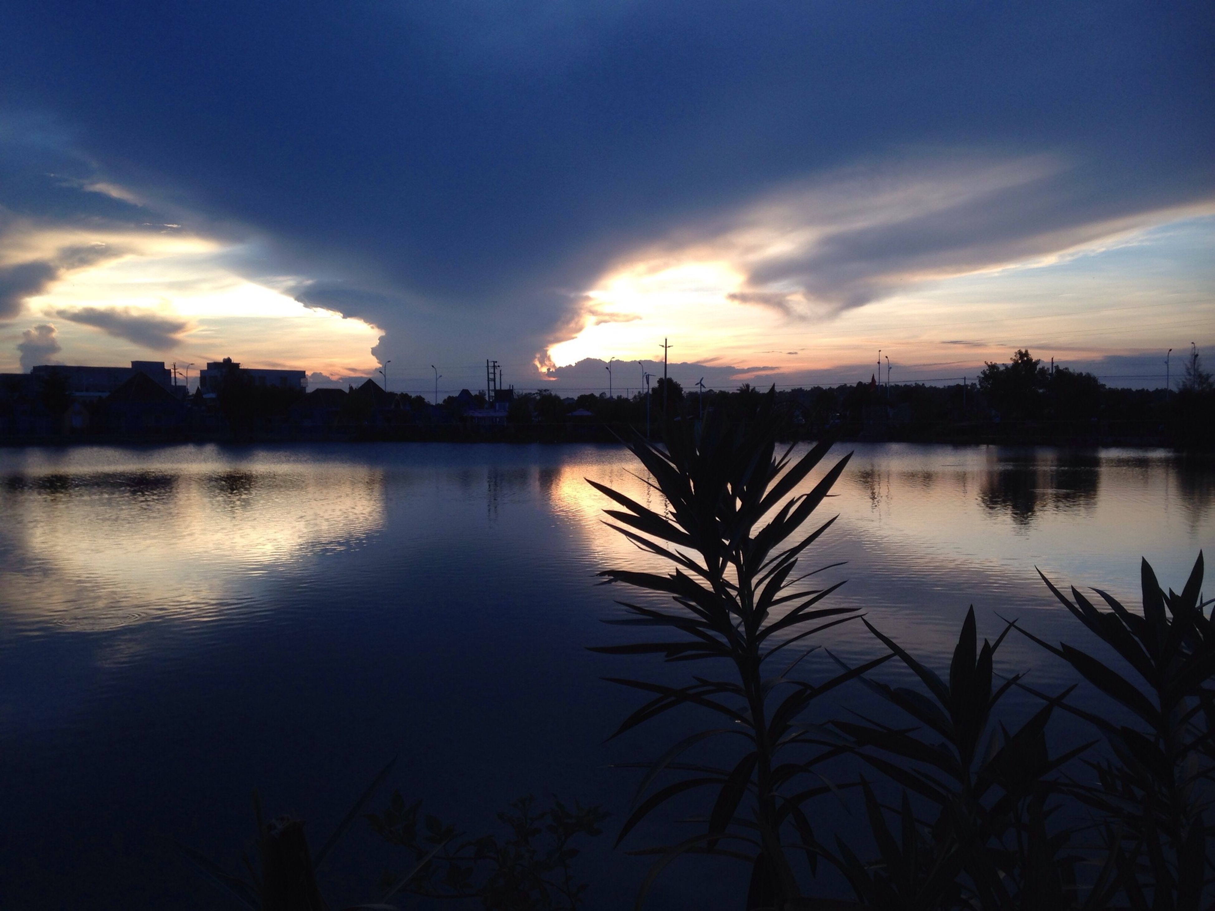 sunset, sky, water, silhouette, reflection, scenics, lake, tranquil scene, cloud - sky, tranquility, beauty in nature, cloud, nature, idyllic, dusk, river, waterfront, tree, no people, outdoors