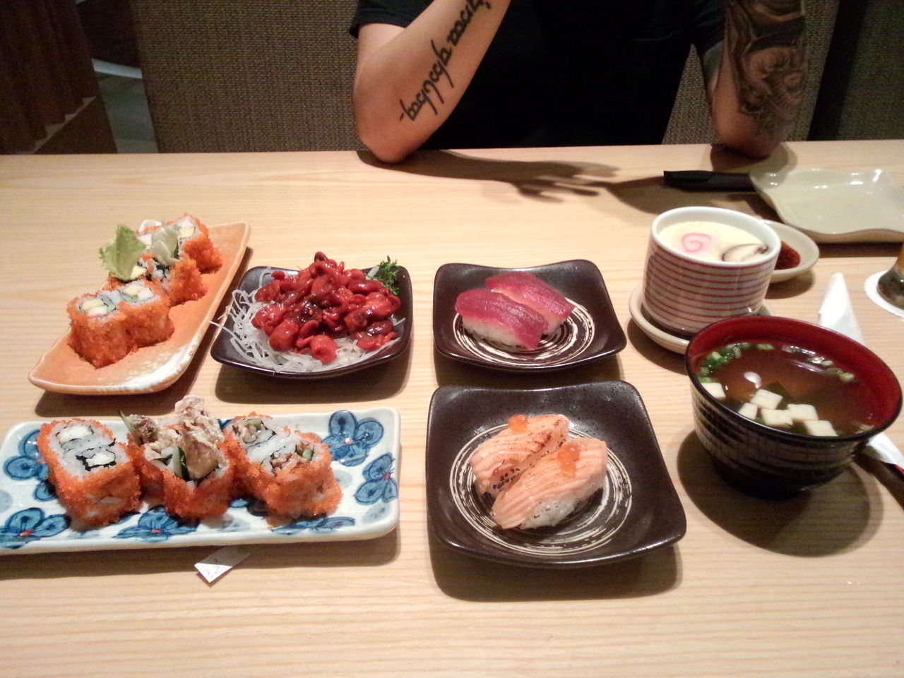 food, food and drink, plate, freshness, table, seafood, indoors, real people, ready-to-eat, variation, serving size, meat, one person, healthy eating, high angle view, bowl, meal, sushi, day, close-up, people