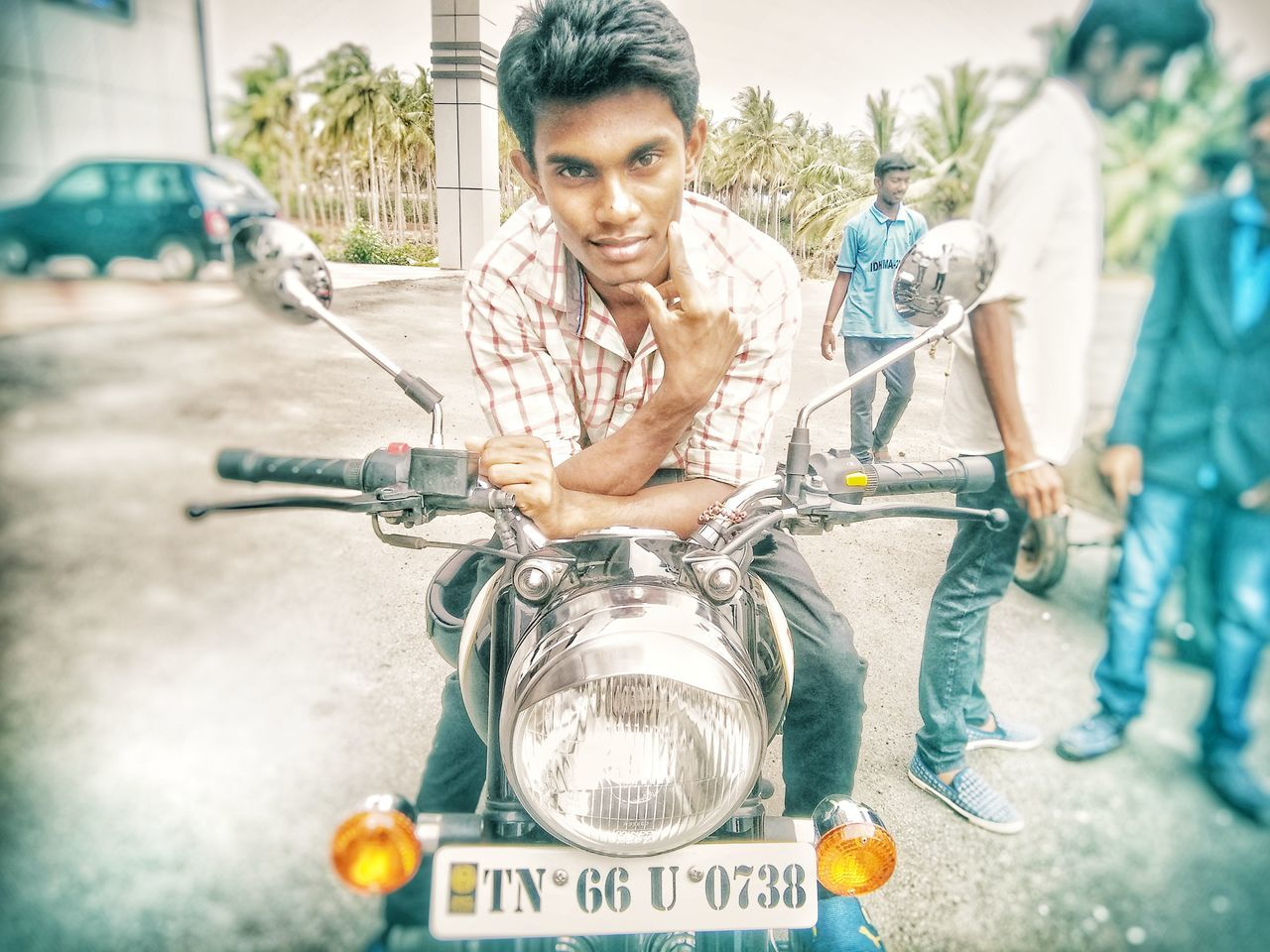 transportation, front view, motorcycle, street, mode of transport, one person, casual clothing, bicycle, mid adult, outdoors, looking at camera, portrait, road, men, day, mature adult, land vehicle, real people, smiling, city, one man only, young adult, adults only, adult, biker, people, only men
