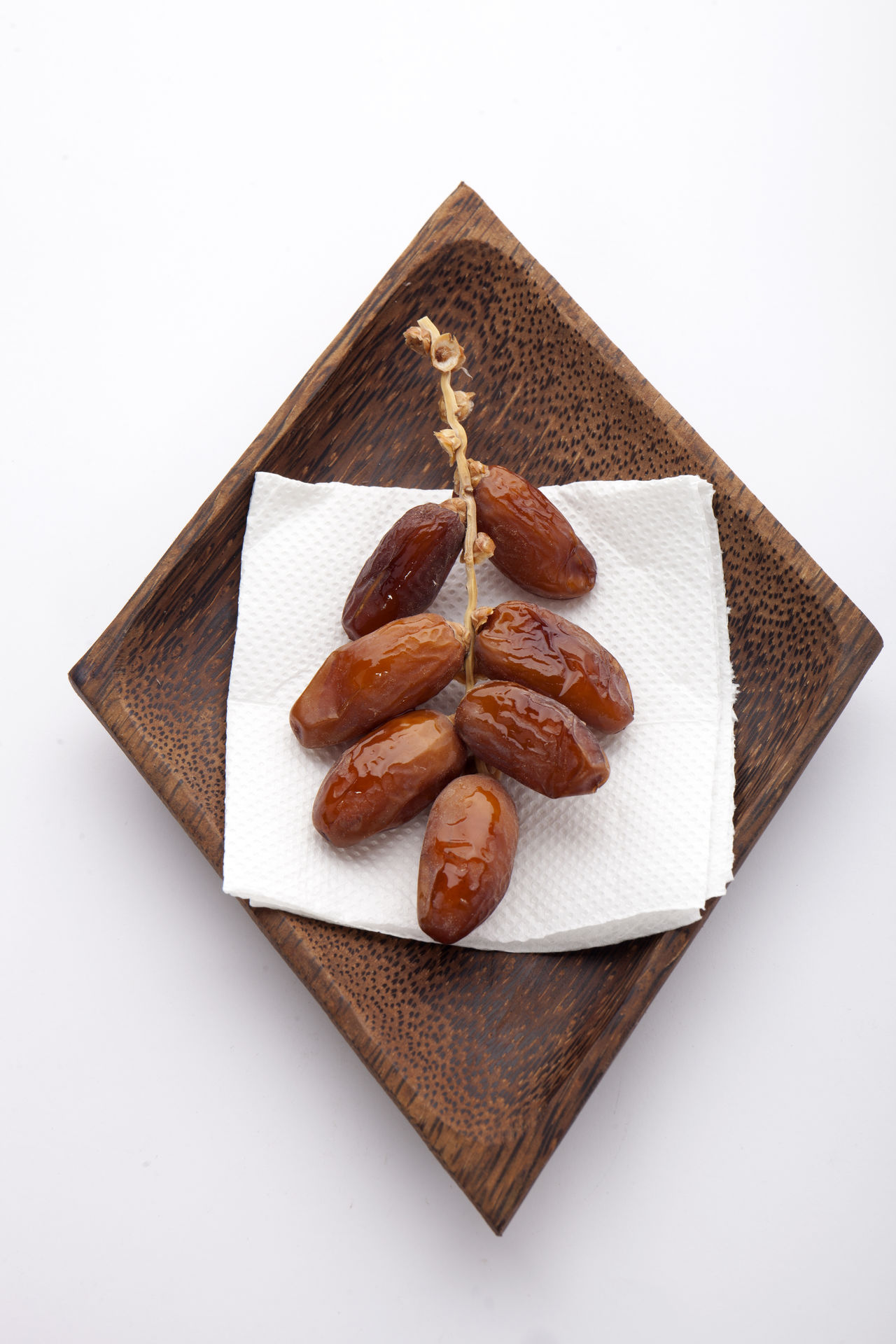 Date Fruit Close-up Color Image Date Fruit Day Dried Fruit Focus On Foreground Food Food And Drink Freshness Fruit High Angle View Indoors  Ingredient No People Photography Ready-to-eat Still Life Studio Shot Vertical White Background