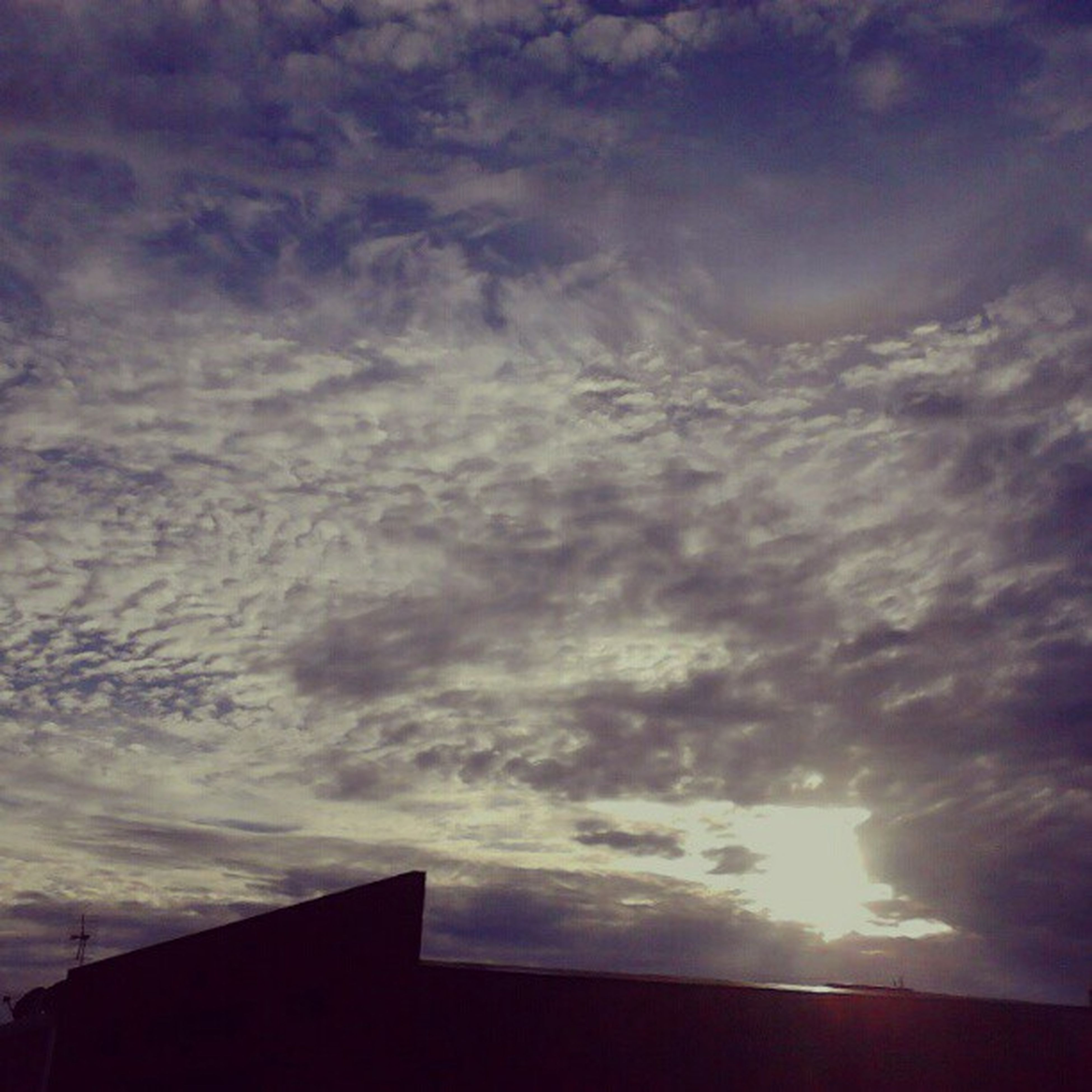 sky, building exterior, architecture, cloud - sky, built structure, low angle view, sunset, cloudy, silhouette, cloud, house, weather, beauty in nature, nature, scenics, high section, overcast, building, outdoors, cloudscape