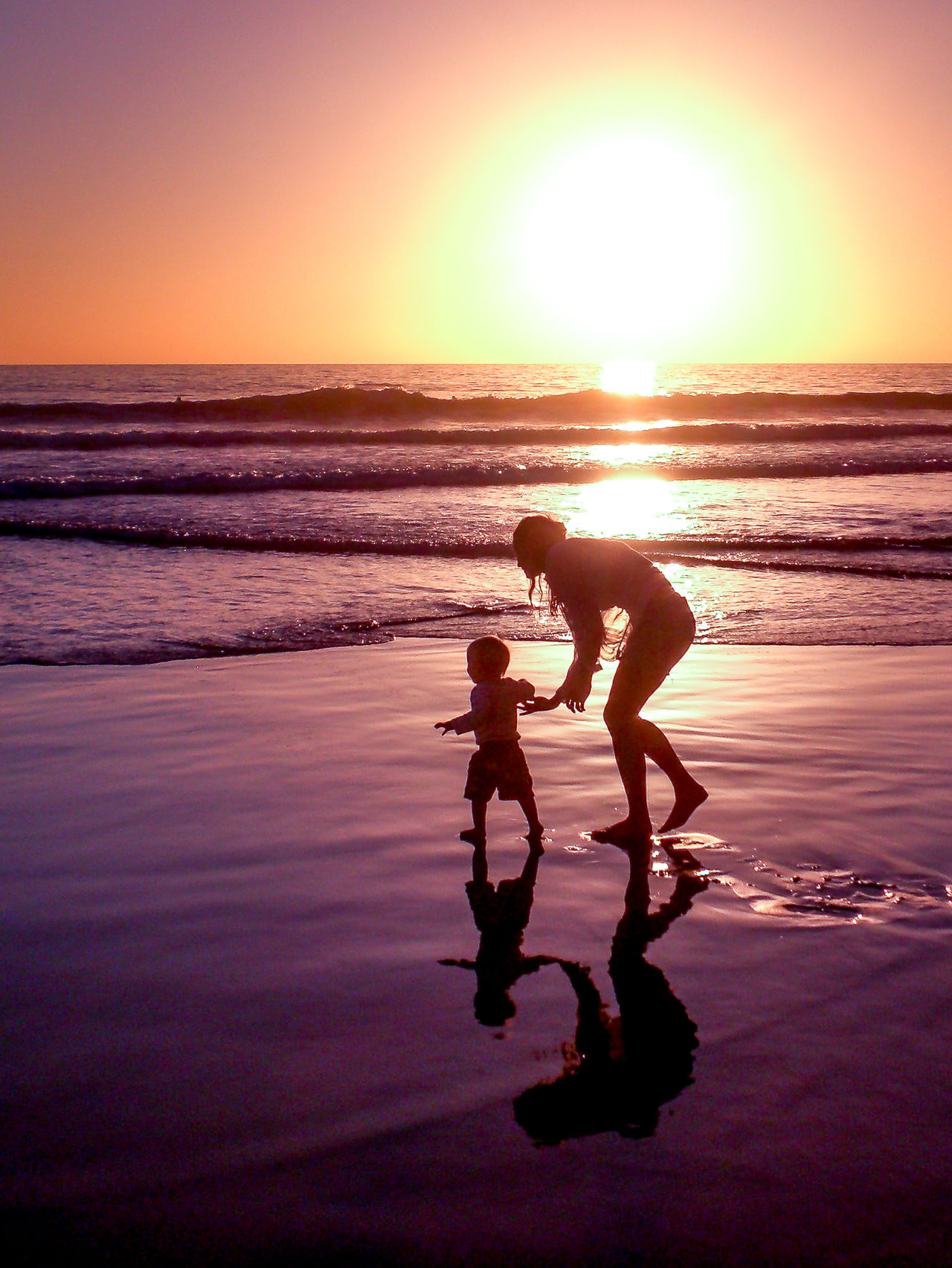 Mother and Sun Anka Point Beach Canonphotography Enjoyment Fun Horizon Over Water Idyllic Kids Leisure Activity Love Children Love Kids Morocco Orange Color People In Silhouette Reflections In The Water Sea Shadows And Backlighting Silhuette Sundown Sunset Taghazout