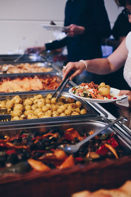 Warm food at Event Buffet Buffet Time Catering Catering Service Eat Eating Event Event Photographer EventPhotography Events Food Food And Drink Food And Drink Food Tray Help Yourself Human Hand Indoors  One Person Pasta People Eating People Getting Food Real People Trays Warm Food