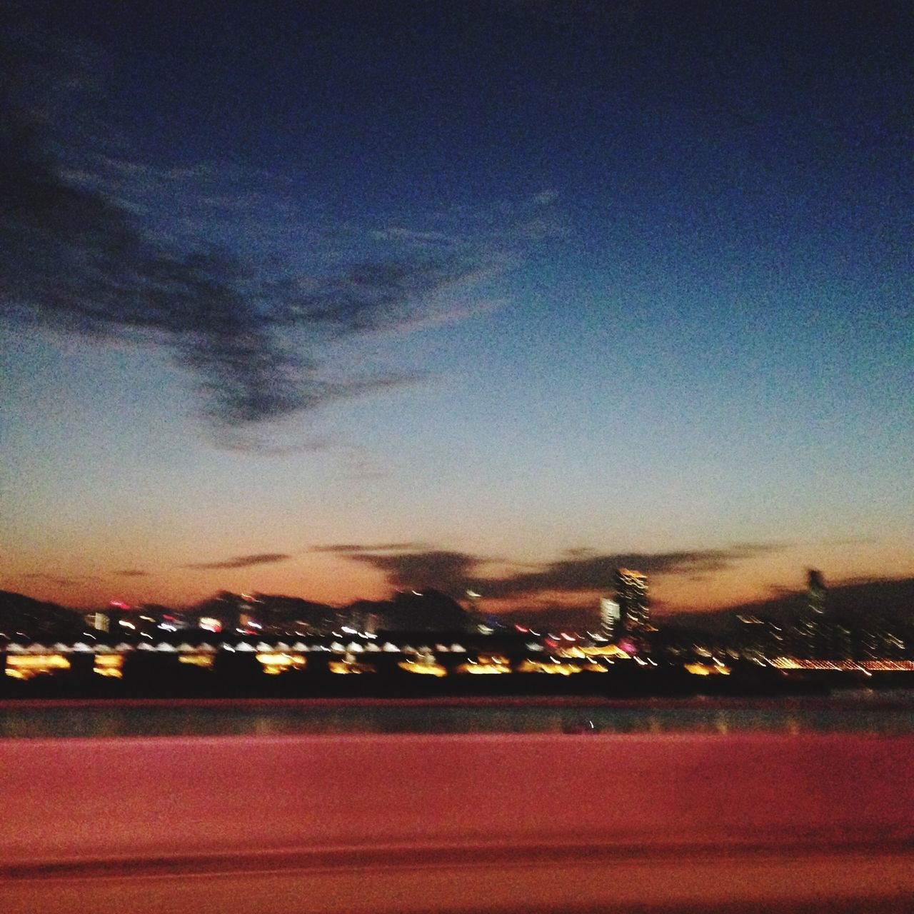 sunset, sky, night, dusk, illuminated, no people, outdoors, motion, cloud - sky, nature, road, beauty in nature, city, architecture