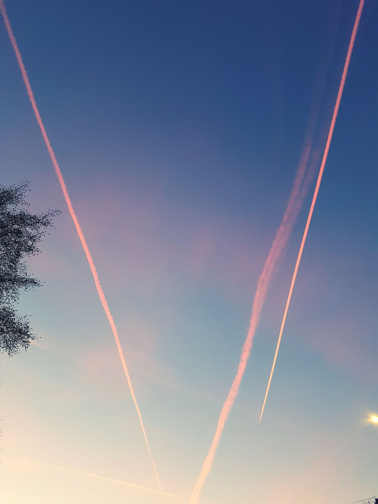 Planes fly over at dusk in London. Flying Airplane Motion No People Speed Outdoors Sky Multi Colored Dusk Sky Magic Hour Planespotting Looking Up Blue Flight Path Flight Plane Aeroplane Night Sky Pink Sky EyeEmNewHere EyeEmNewHere