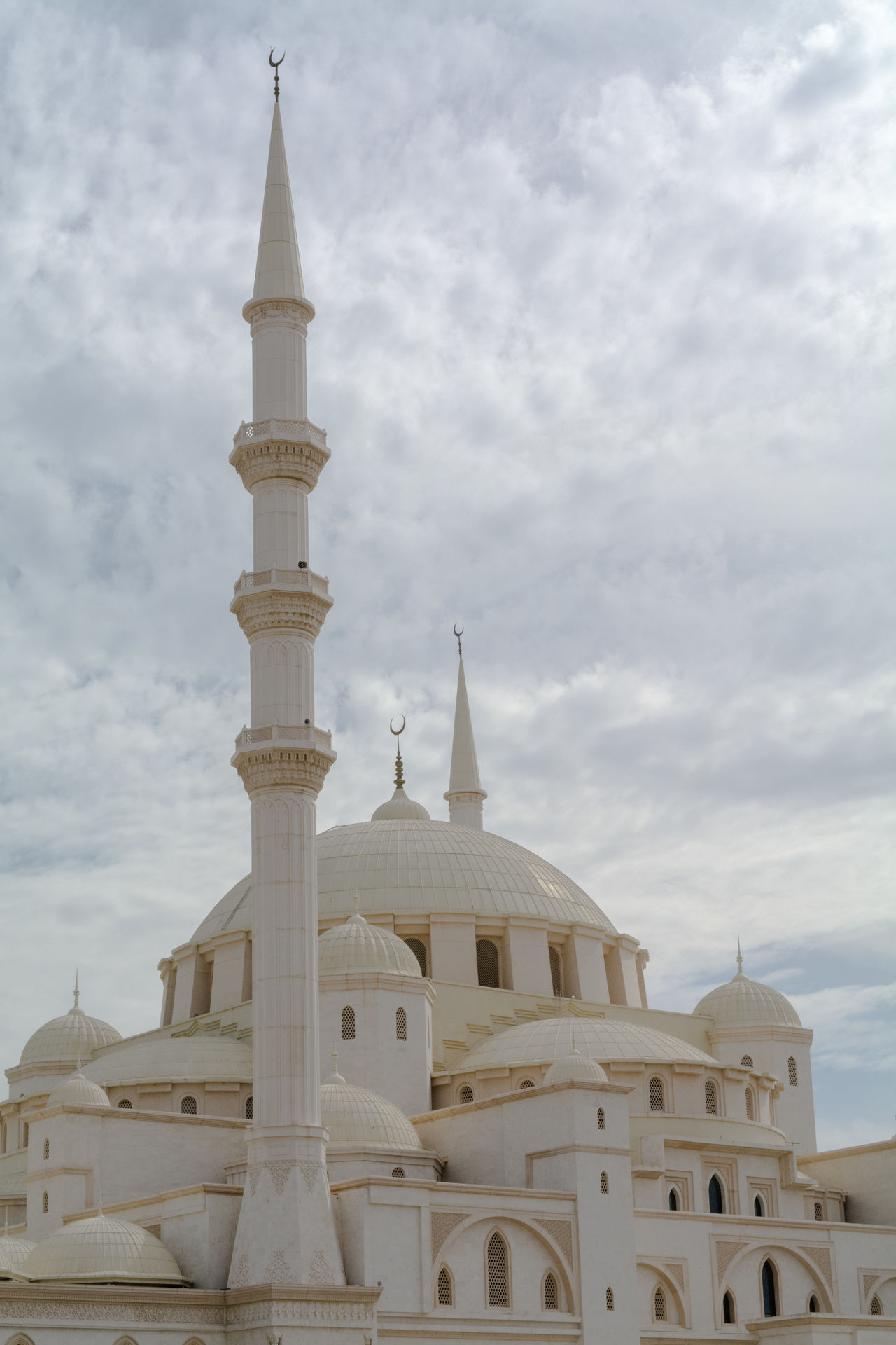 Architectural Feature Architecture Building Exterior Built Structure City Cloud Cloud - Sky Cloudy Day Dome Exterior Fujairah High Section Islamic Architecture Low Angle View Minaret Mosque No People Outdoors Place Of Worship Religion Sky Spirituality Tourism Travel Destinations