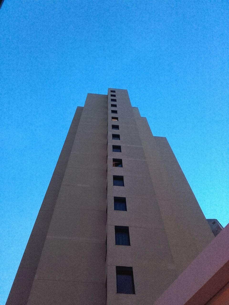 low angle view, architecture, built structure, blue, building exterior, day, no people, clear sky, outdoors, sky