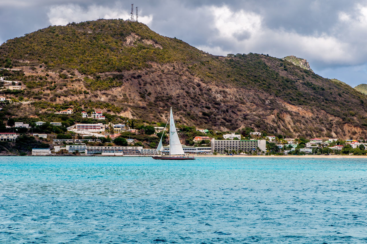 mountain, sea, water, sky, outdoors, beauty in nature, nature, cloud - sky, no people, day, tranquil scene, tranquility, scenics, architecture, waterfront, travel destinations, built structure, building exterior, nautical vessel