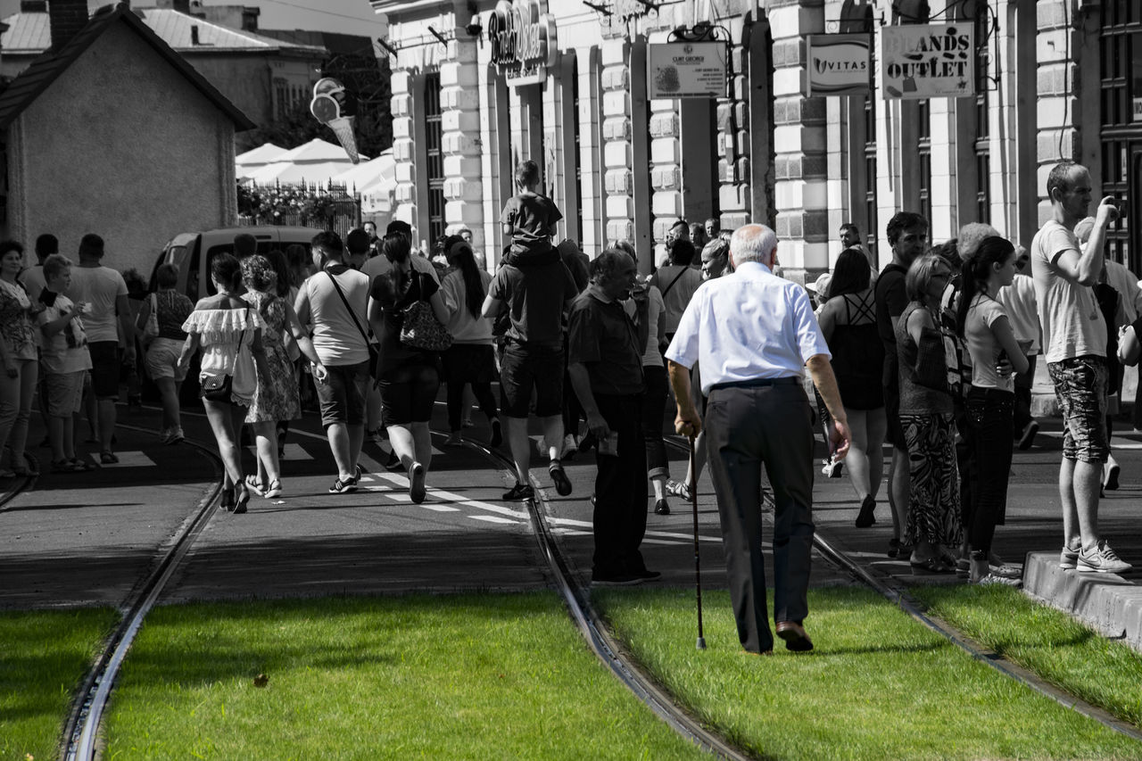 Black And White With A Splash Of Colour Crowd Crowded Experimental Green Large Group Of People Life Life In Motion Lifestyle Lifestyles Man Old Old Man Old People People People Photography People Watching Peoplephotography Person Sad Drastic Edit Selective Color Storytelling People And Places Walking