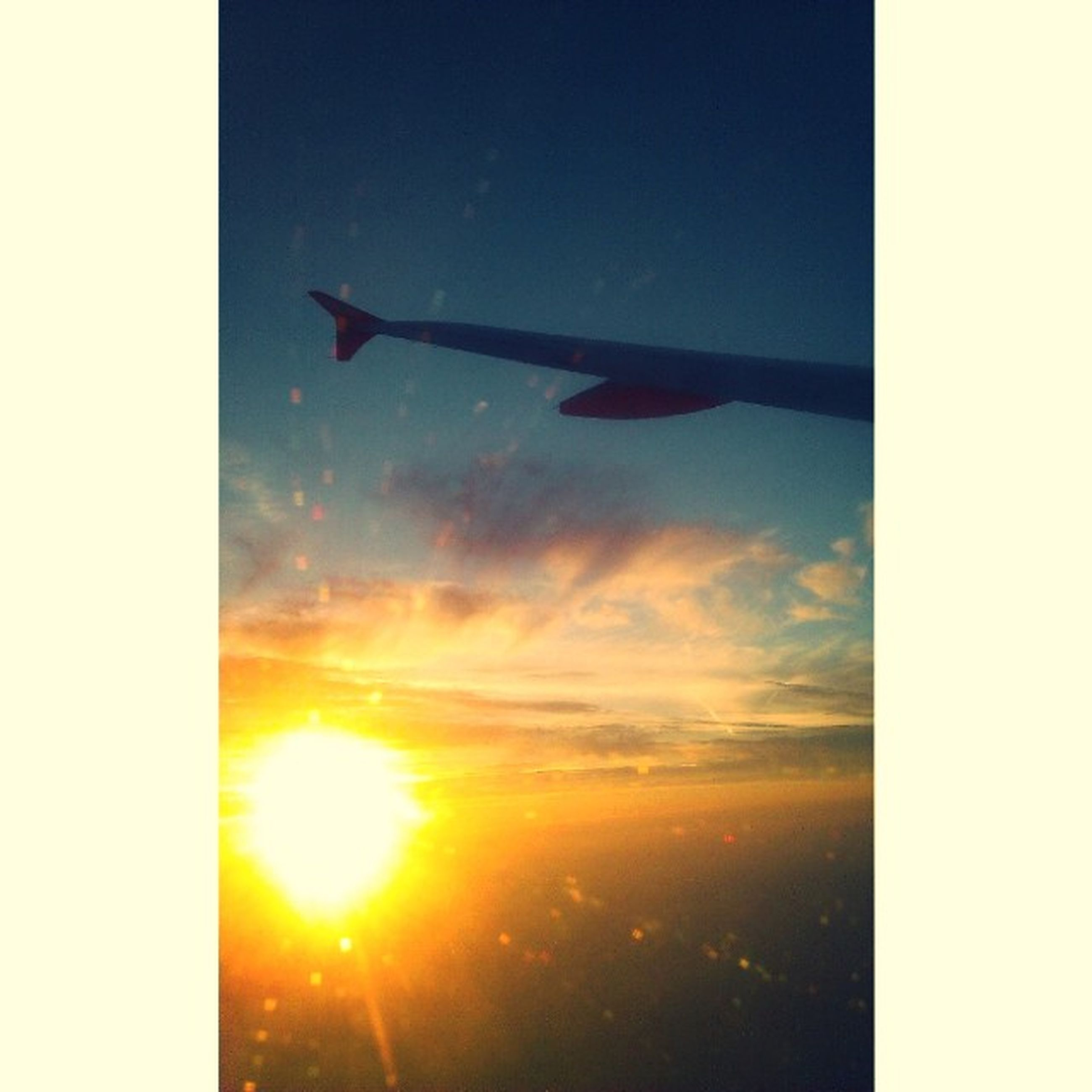 sunset, airplane, flying, sun, transportation, air vehicle, mode of transport, sky, aircraft wing, scenics, travel, beauty in nature, cloud - sky, orange color, mid-air, sunlight, nature, journey, on the move, tranquil scene