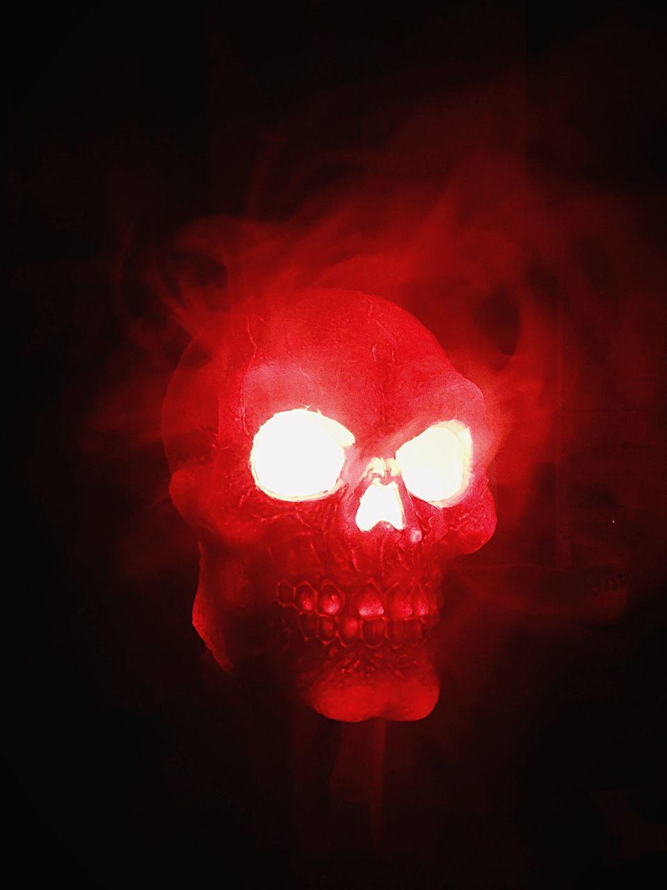 Close-Up Of Illuminated Red Skull
