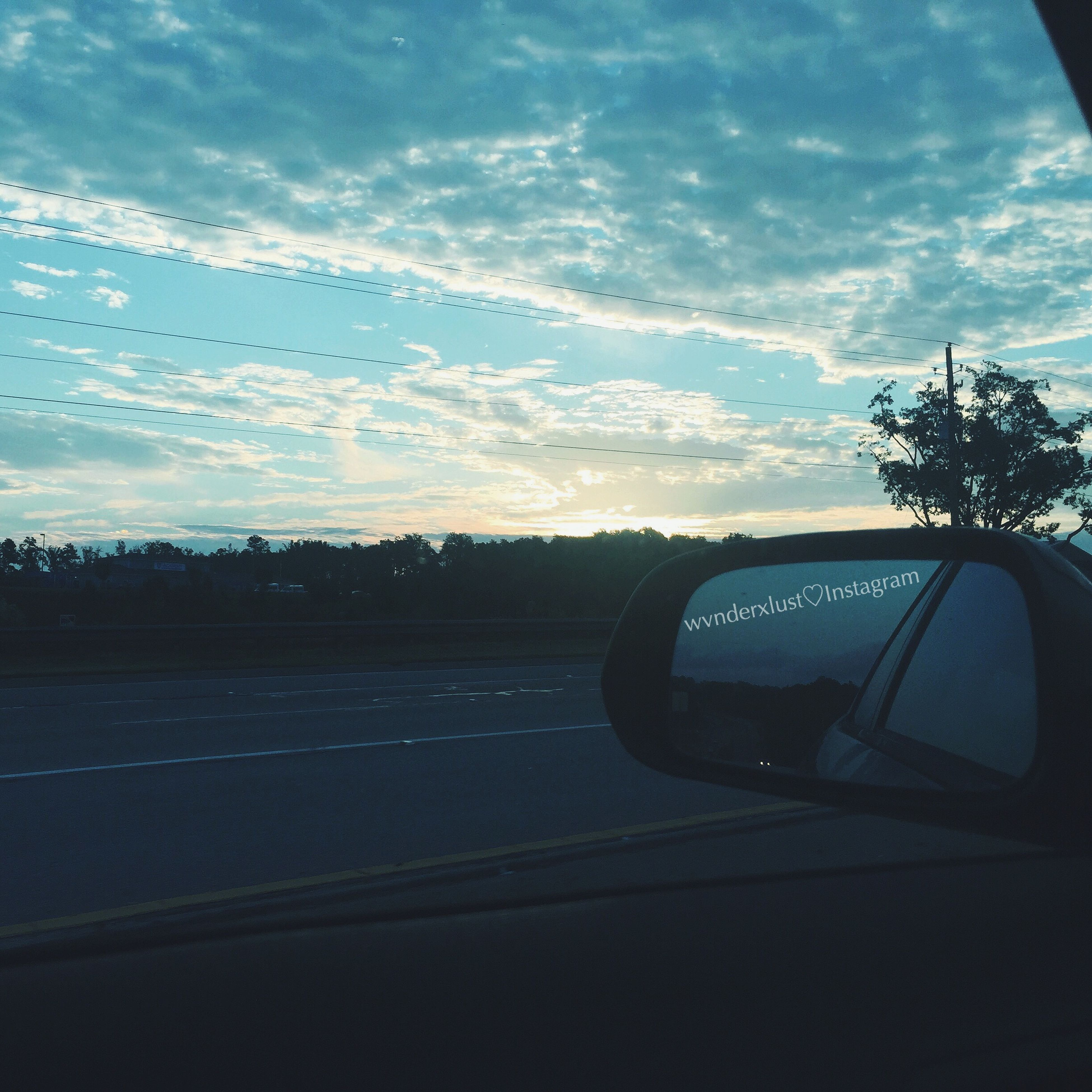 transportation, land vehicle, mode of transport, car, road, sky, vehicle interior, cloud - sky, windshield, car interior, on the move, road marking, glass - material, street, tree, silhouette, travel, cloud, transparent, landscape