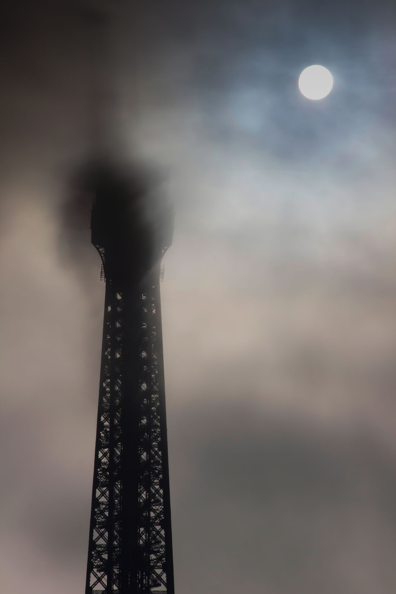 Shooting the Eiffel Tower and Trocadero on several occasions/assignments. Architecture Beautiful Light Capital Cities  Cloud - Sky Eiffel Tower Foggy Day Head Up In The Clouds International Landmark Landmark Only Partially Visible Paris Pattern Rare Weather Phenomenon Sky Steel Structure Sun Rising Against Fine Art Photography