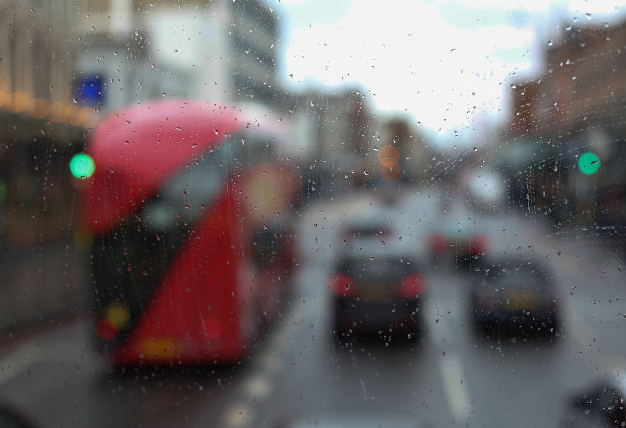London transportation through the rainy glass Blue Britain Cam Chelsea City Transportation Close-up Day Grey Weather London Eye Mayor Of London Rain Red Bus Reflection Relaxing River Streetphotography Through The Glass Tranquility Transport For London Transport Network