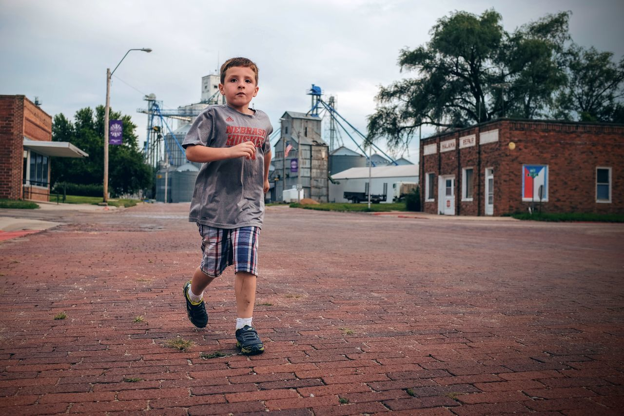 Photo essay, a day in the life. August 24, 2016 Milligan Nebraska 35mm Camera A Day In The Life Boy Brick Lane Camera Work Candid Portraits Casual Clothing Confidence  Elementary Age Everyday Lives Eye For Photography EyeEm Gallery Eyeemphoto FujiX100S Full Length Jogging Kids Being Kids Lifestyles Looking At Camera Photo Essay Running Small Town Stories Storytelling Street Streetphotography The Street Photographer - 2017 EyeEm Awards