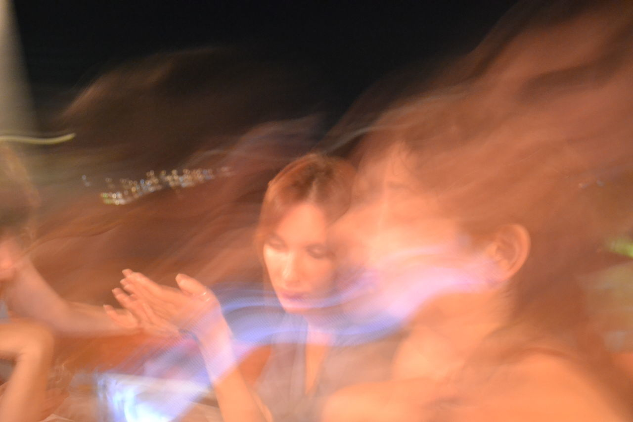 Blur Blurred Motion Headshot Lifestyles Light Multiple Exposure Night Night Sky People Real People Vacations Women Young Women