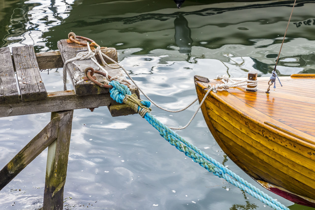 Blue Boat Day Fixed High Angle View Lake Leash Mode Of Transport Moored Nature Nautical Vessel No People Outdoors Pier Reflection Rippled River Rope Ropes RopesandChains Tighten Transportation Water Waterfront Showing Imperfection
