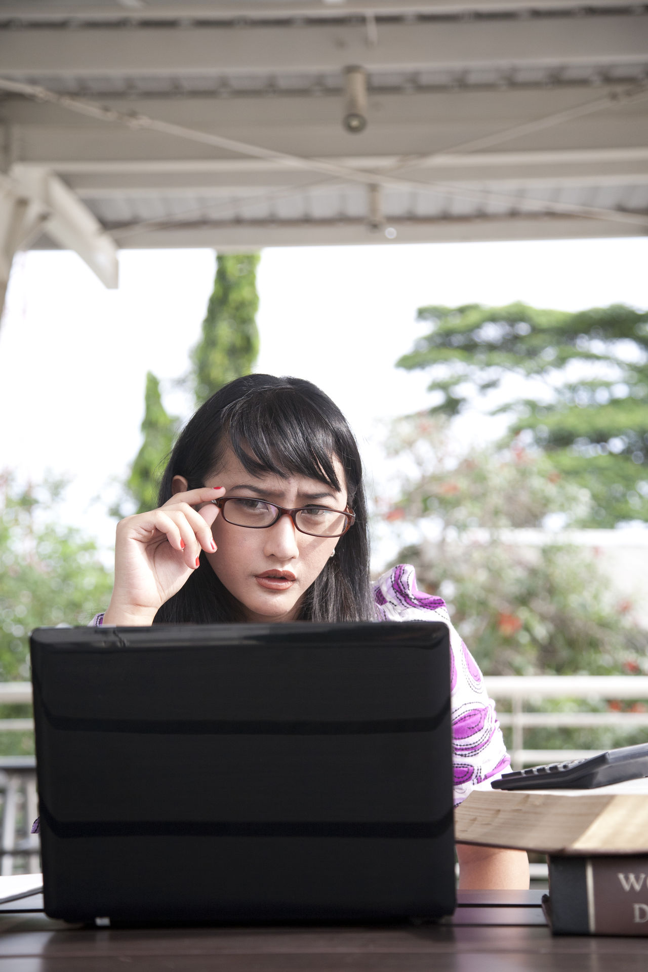 Adult Business Business Finance And Industry Communication Day E-learning Eyeglasses  Front View Indoors  Learning One Person One Woman Only One Young Woman Only Only Women People Sitting Student Table Technology University Student Using Laptop Wireless Technology Women Working Young Adult